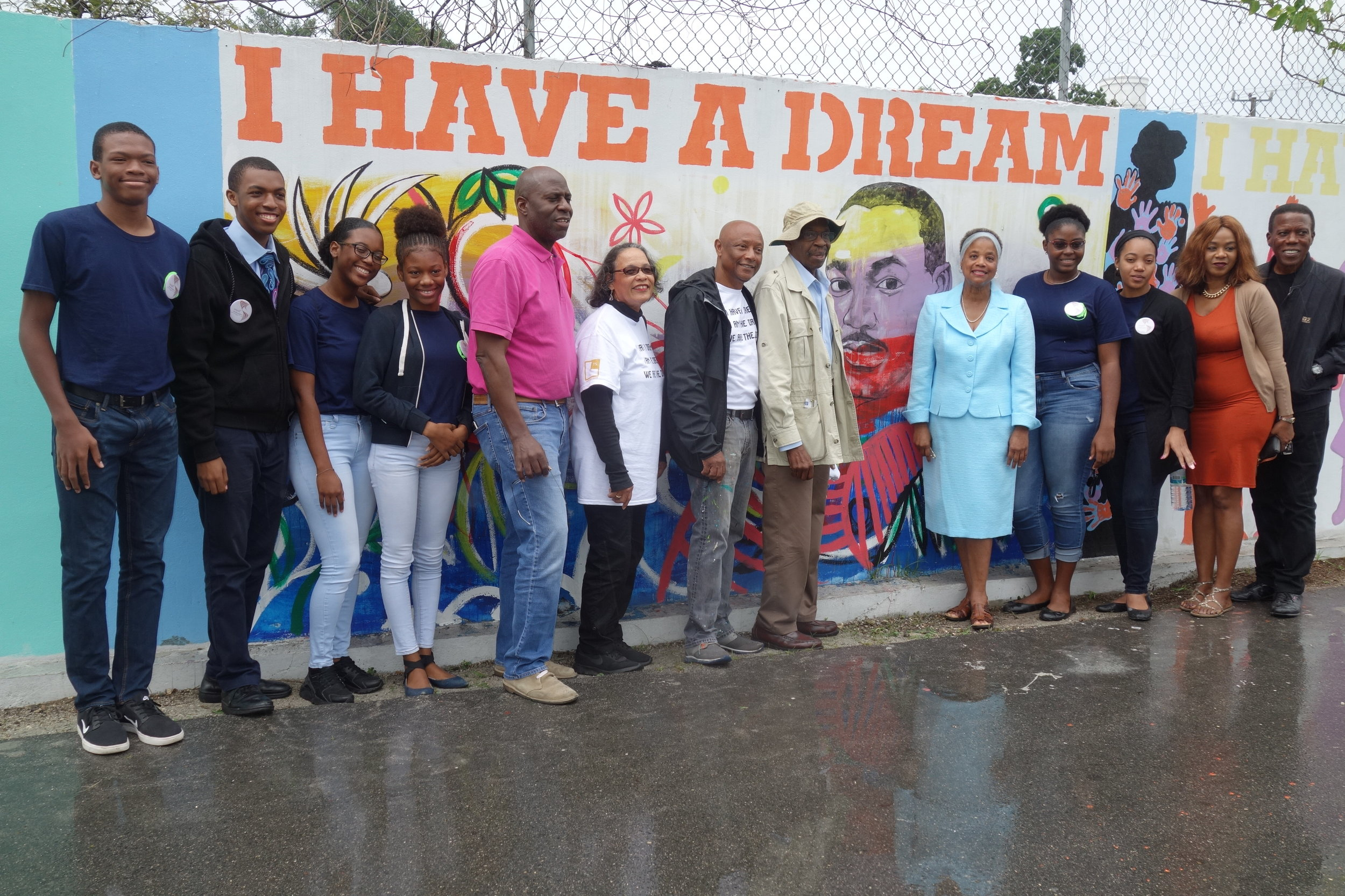 The LAHB and TS teams pose with Rosalie Fawkes in front of the MLK mural by Jodi Minnis. Photography courtesy of Dede Brown.