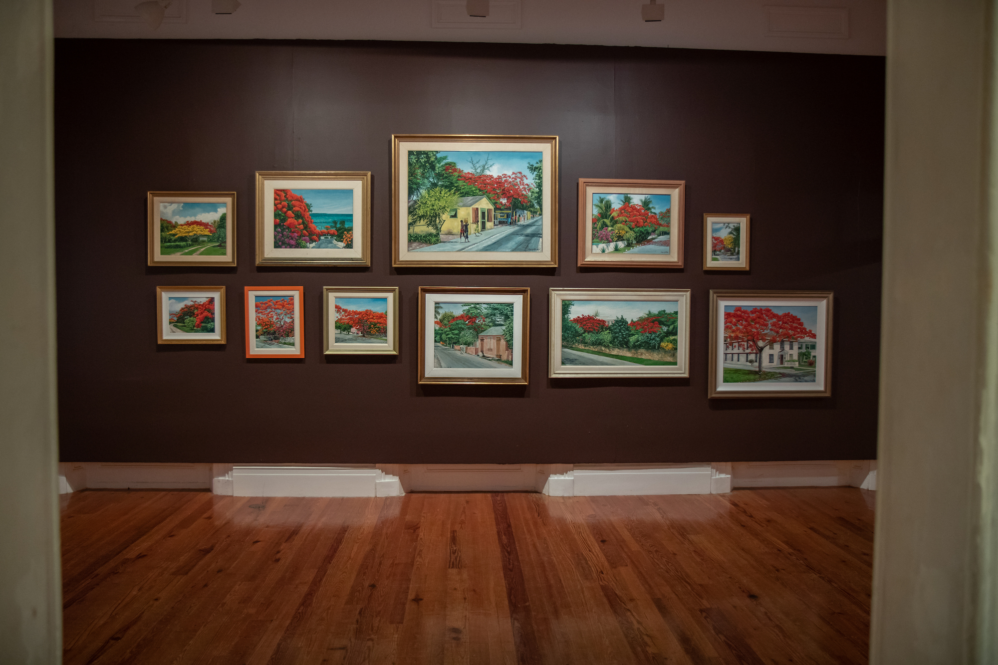 """Installation shot of Chan Pratt's """"Resurrection"""" featuring the poinciana room. Image courtesy of Jackson Petit and the National Art Gallery of The Bahamas."""