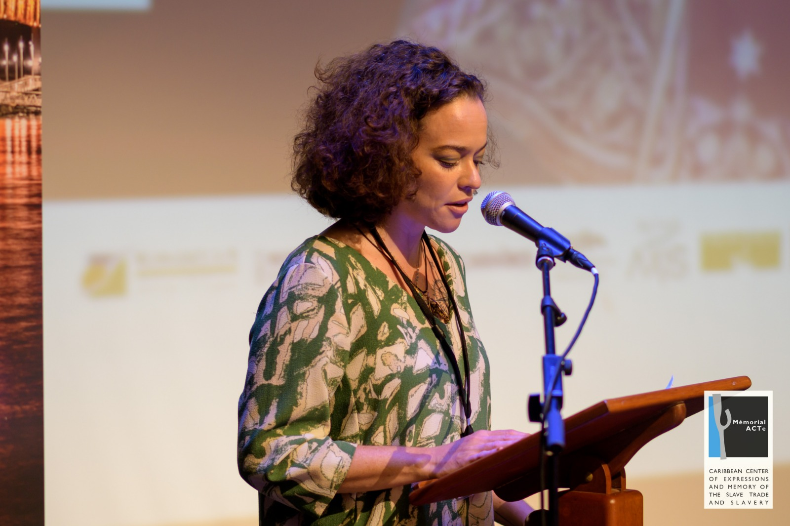 Chief Curator, Holly Bynoe, announcing the hosting of the next convening of Tilting Axis 6 which will be held in The Bahamas at the NAGB. Image courtesy Guillaume Aricique and Memorial ACTe