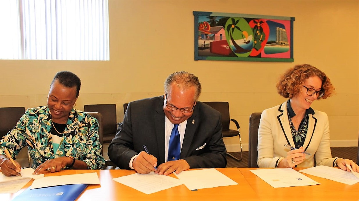 Shown signing the MOU and agreement are UB Provist Dr. Linda A. Davis, UB President Dr. Rodney D. Smith and NAGB Director MRs. Amanda Coulson.
