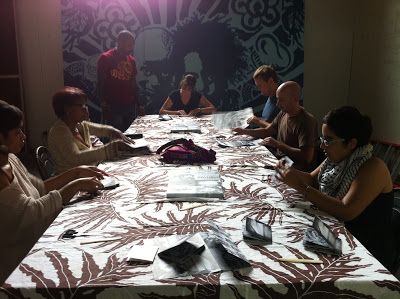 NAGB staff and volunteers fold and compile booklets for the catalogue. Image courtesy of Sonia Farmer,    Poinciana Paper Press   .