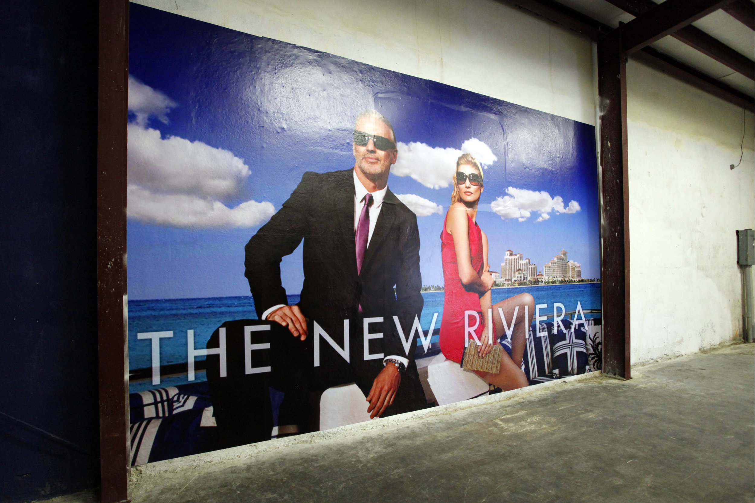 """""""The New Riviera"""". Blue Curry. Billboard poster. 20 x 12 feet, 2014. Image courtesy of the artist."""