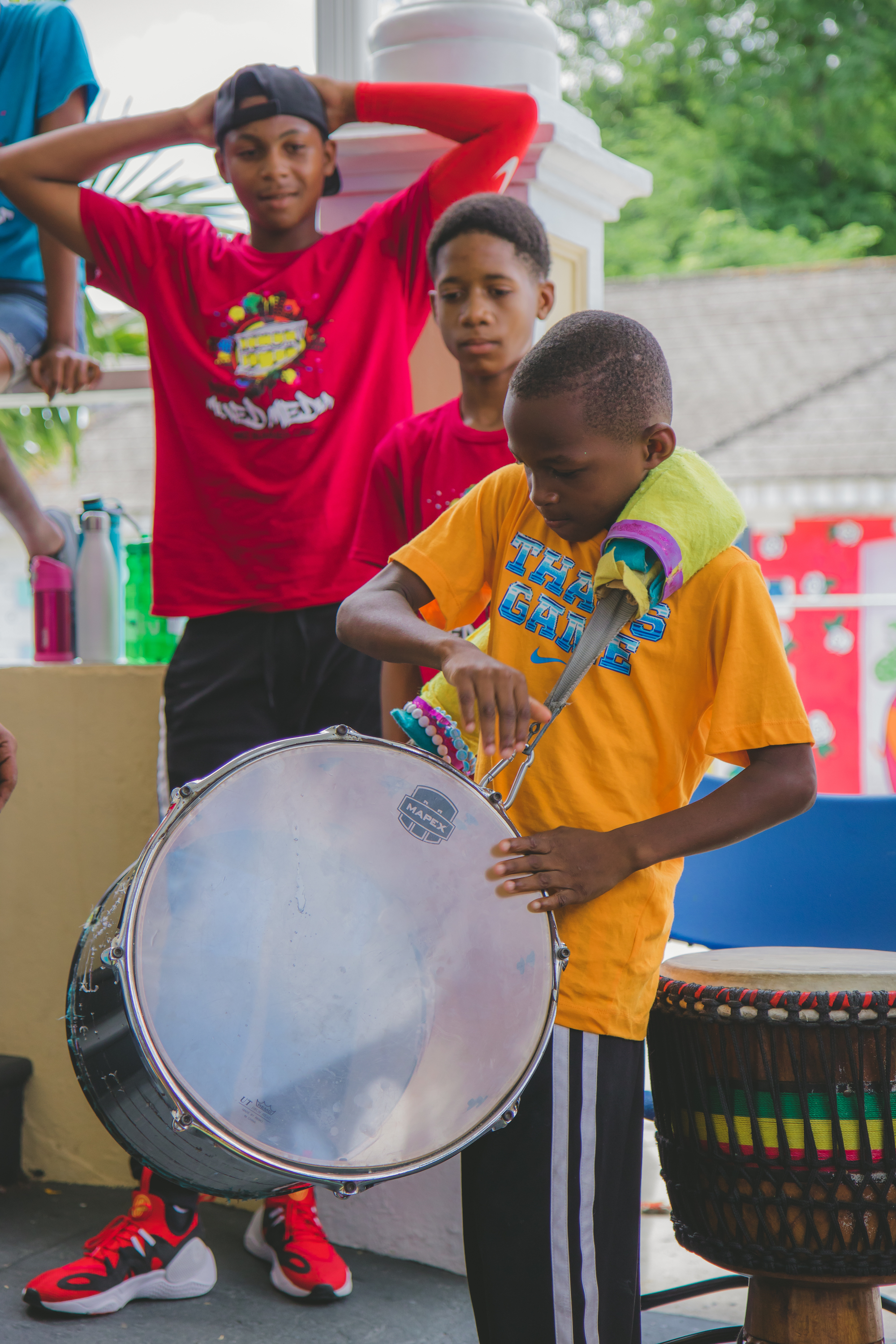 Camper giving a rousing drumming performance with Ubuntu