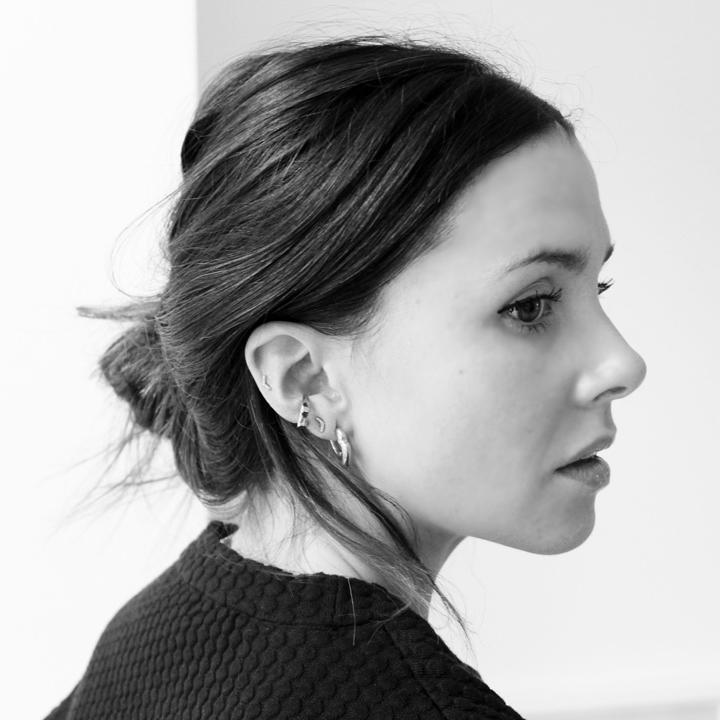 Anneli Bush wearing the Felice Dahl  Första Earrings  and  Ear Cuff
