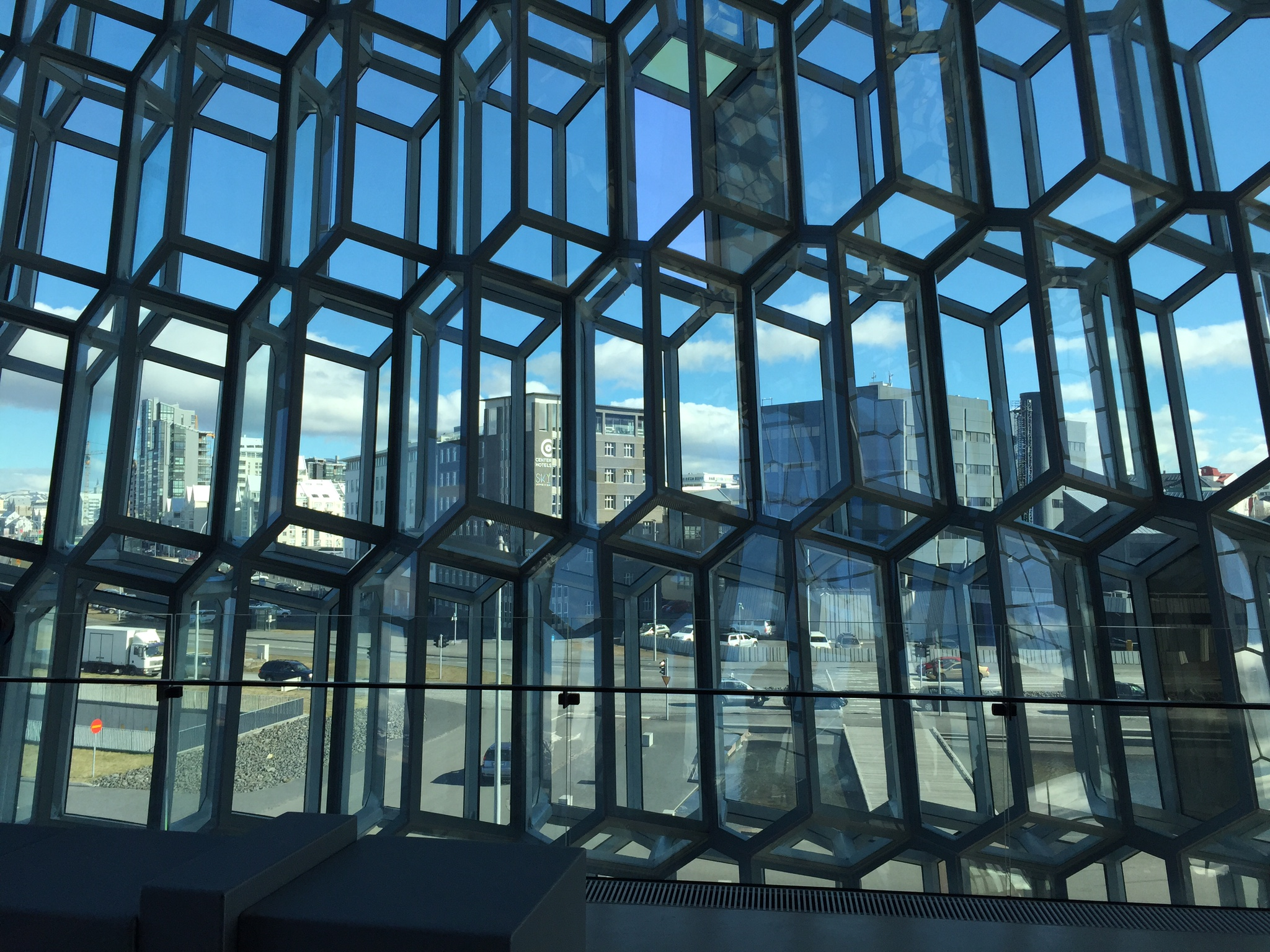 Central Bank of Iceland, seen through the glass facade of the Harpa concert and conference center.
