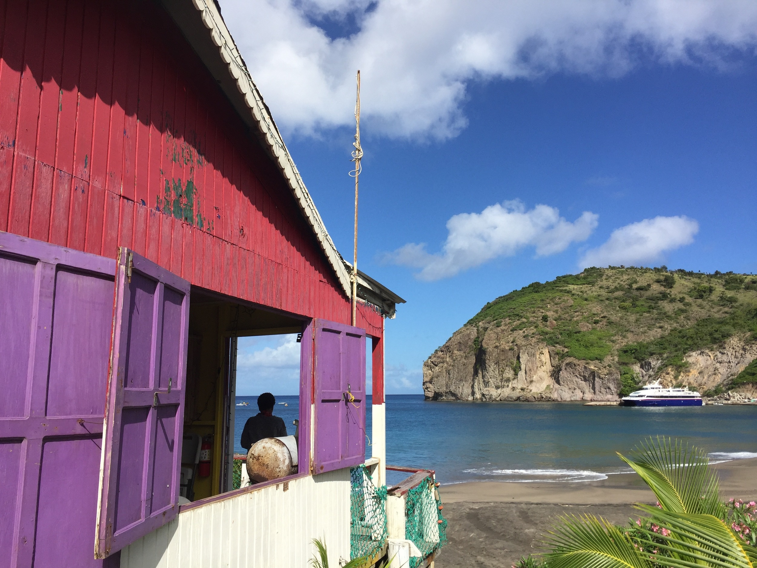 The colorful offices of   Aqua Montserrat on the beach at Little Bay on the quiet northern end of Montserrat. (Photo by Andrew Evans)