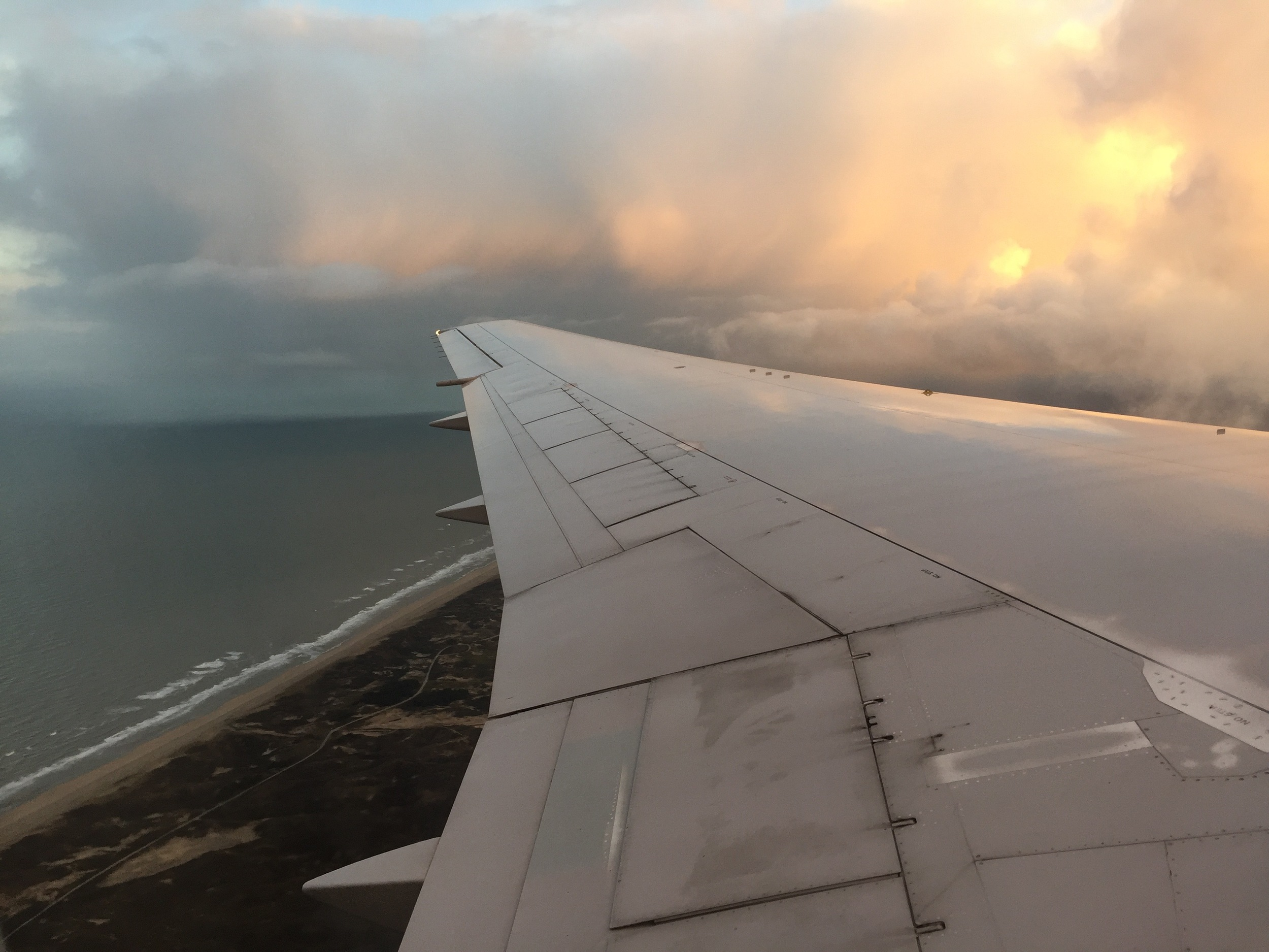 A few hundred feet over the sandy coastline of the Netherlands, just before landing at Schiphol (Photo by Andrew Evans)