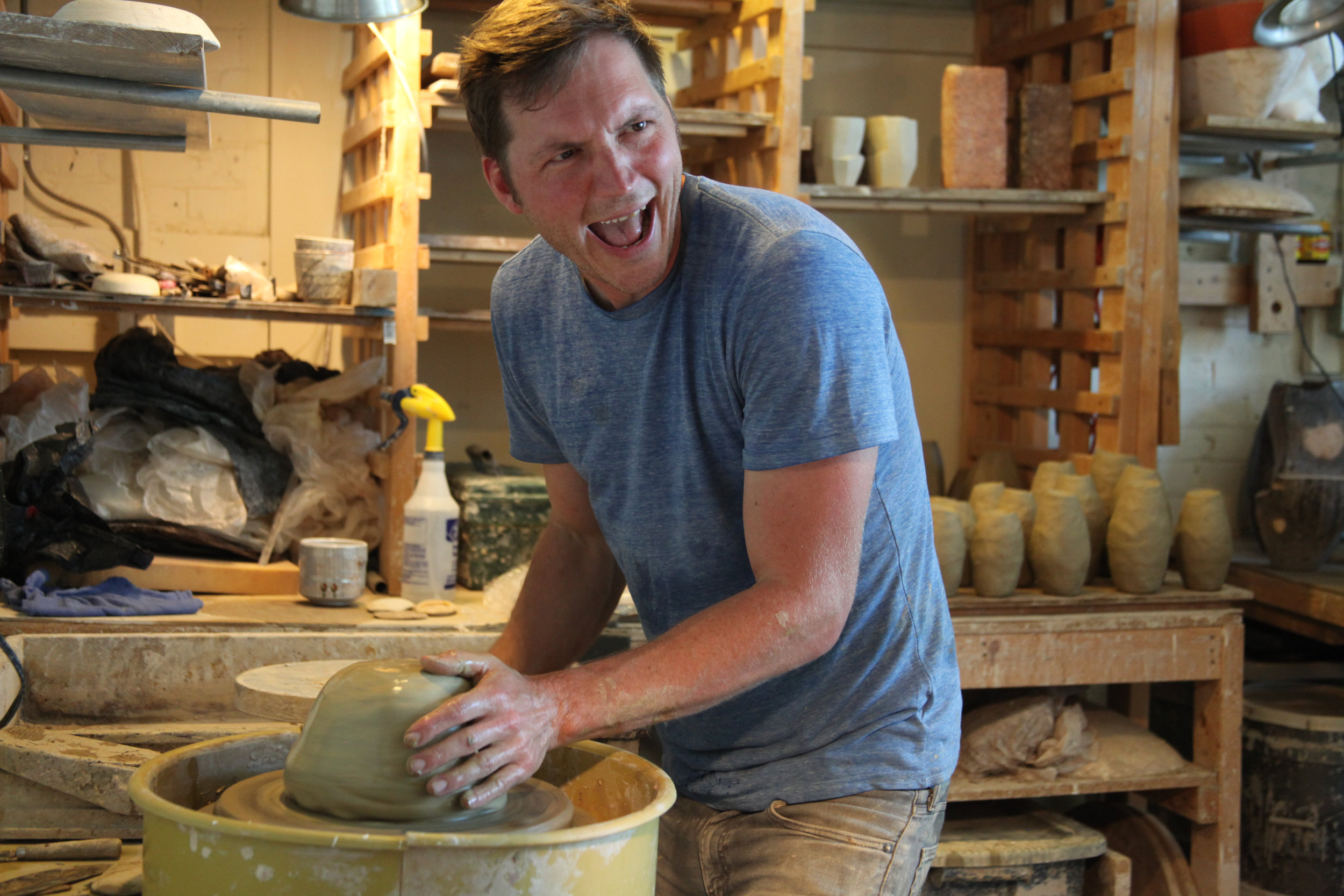 Josh Copus working with wild clay in his studio in Asheville, North Carolina. (Photo by Andrew Evans)
