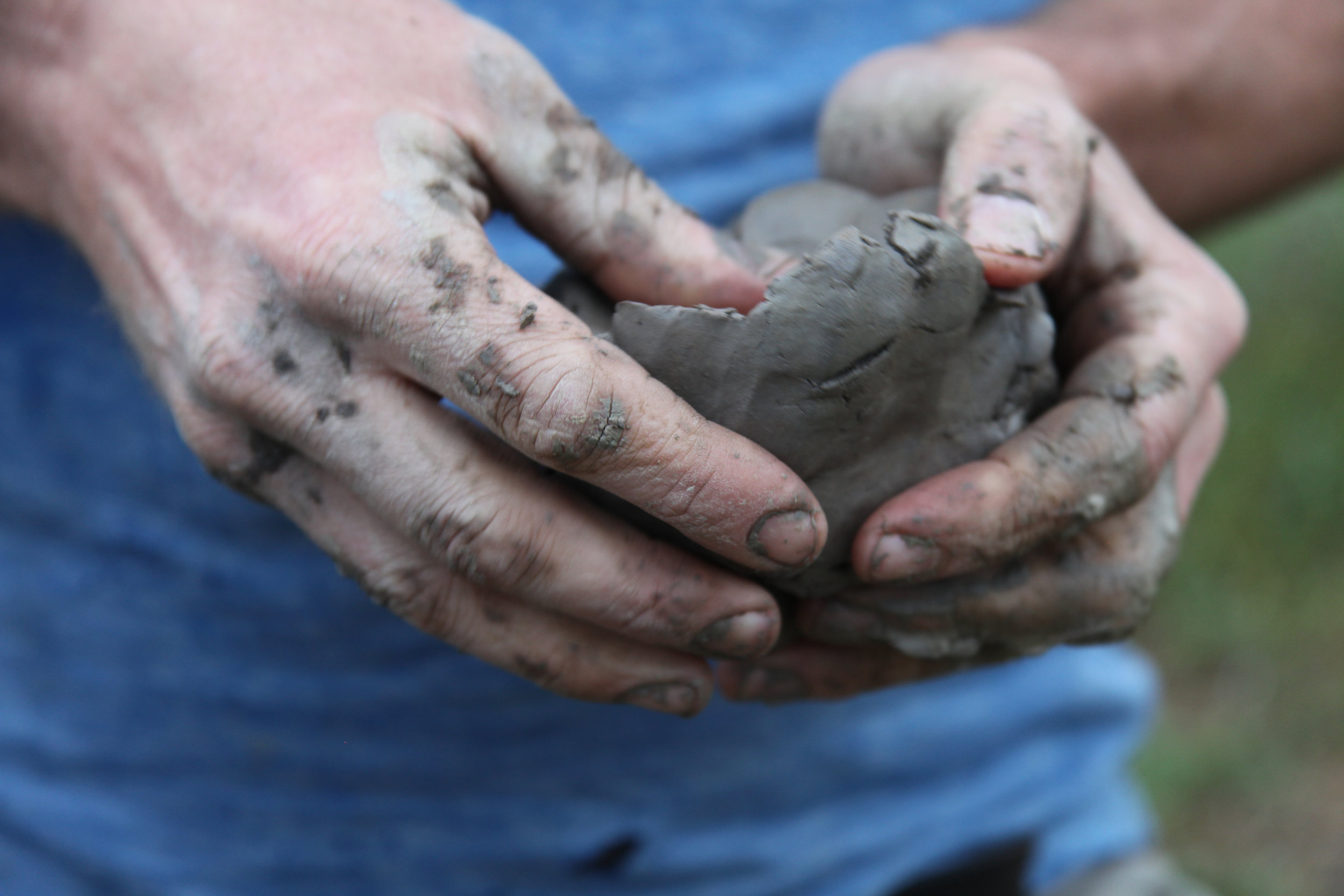Josh Copus works the pure, wild clay he digs straight from the earth. (Photo by Andrew Evans)