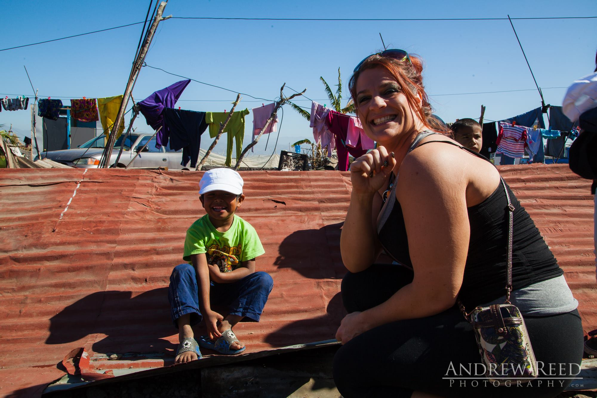 This is Joy :) She designs and sells hats and has recently adopted the 1 for 1 model to give hats to people in need, those undergoing cancer treatment and more. She brought hats and distributed to the children here and at our job site and it was truly amazing to see the smiles on their faces when they received their gift. It was an honor and inspiration to witness her mission.