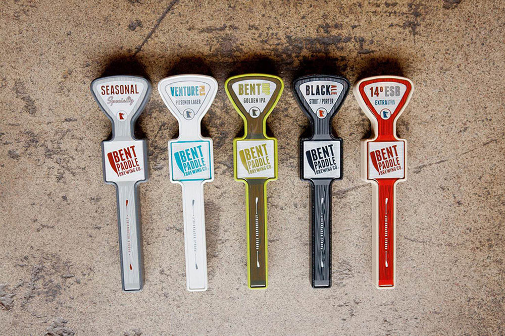 Tap handles, a side project that Greg and his crew worked on for Bent Paddle. Find out more of what they've got brewing in the beer world.