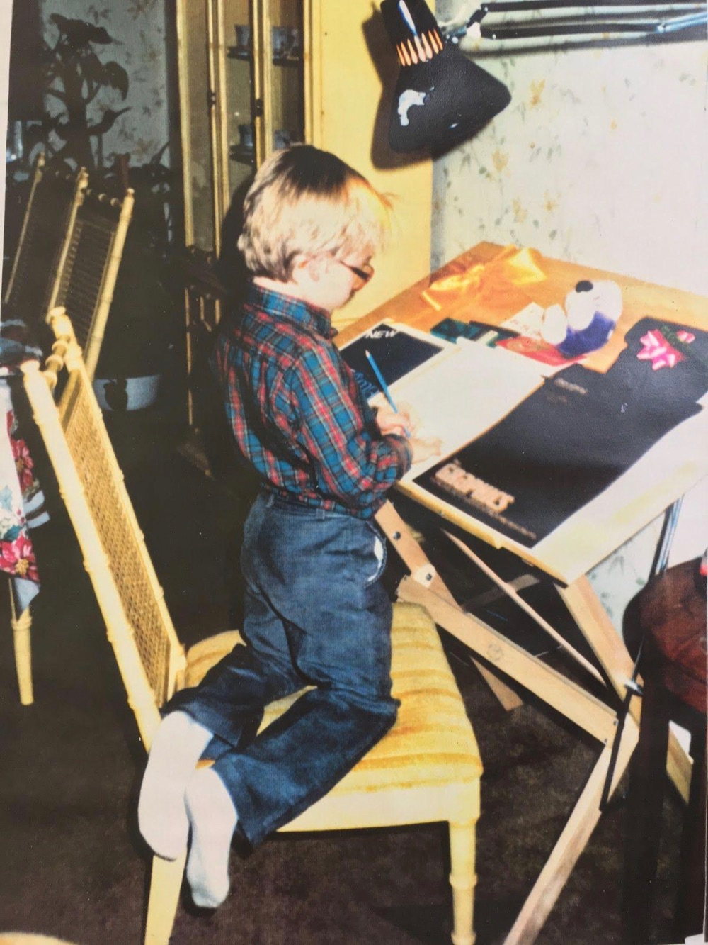 Chris at his first drafting table, courtesy of Uncle Rocky. Age 4 or 5.