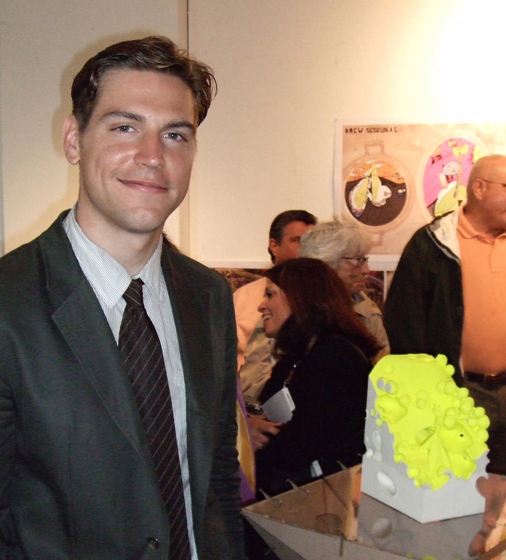 Posing with his 3D printed Thesis model after graduation from Pratt Institute, 2008