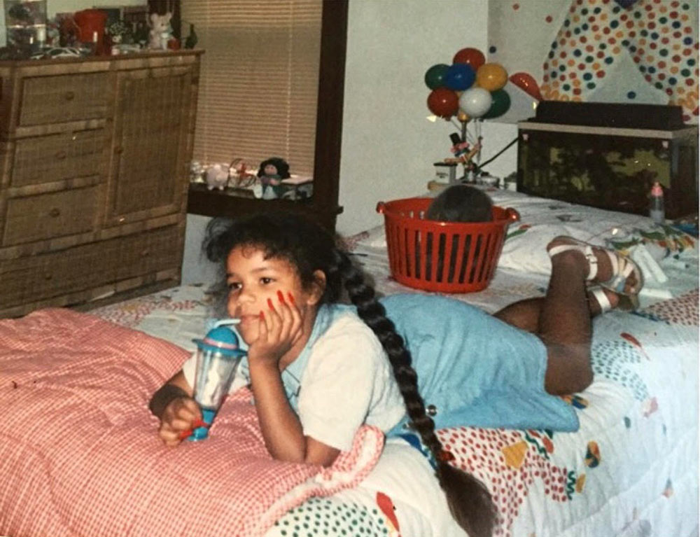 Young Lauren in her room where her mother made the sheets and artwork