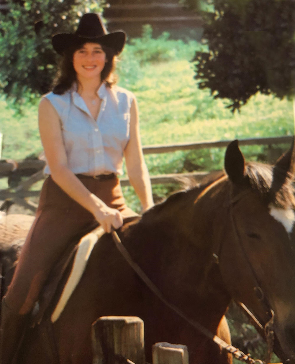 """Gina and her horse."""" This was taken for a magazine article in Hawaii. They wanted me in my english riding outfit and made me put on a western hat. As you can see, this still haunts me today."""""""
