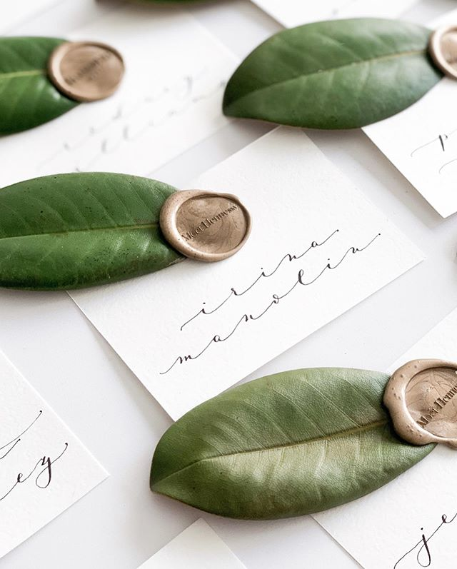 One of the many projects on my desk this week: place cards ft. fresh magnolia leaves and custom wax seals for a multi-brand event with @moethennessy  @belvederevodkaitalia and @woodinvillewhiskeyco (each guest got their corresponding brand's stamp) 🌿 And perfect client to toast the end of a very long week 🥂