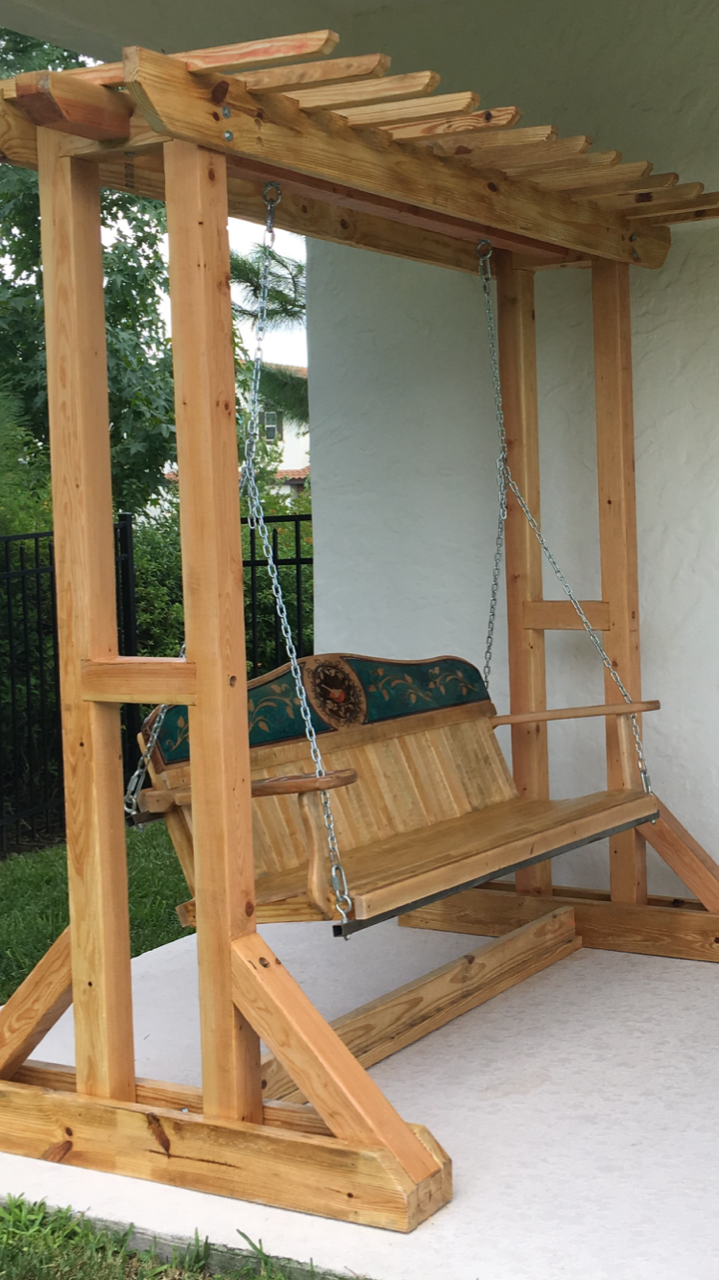 Free-standing maple wood porch swing with pigmented epoxy design
