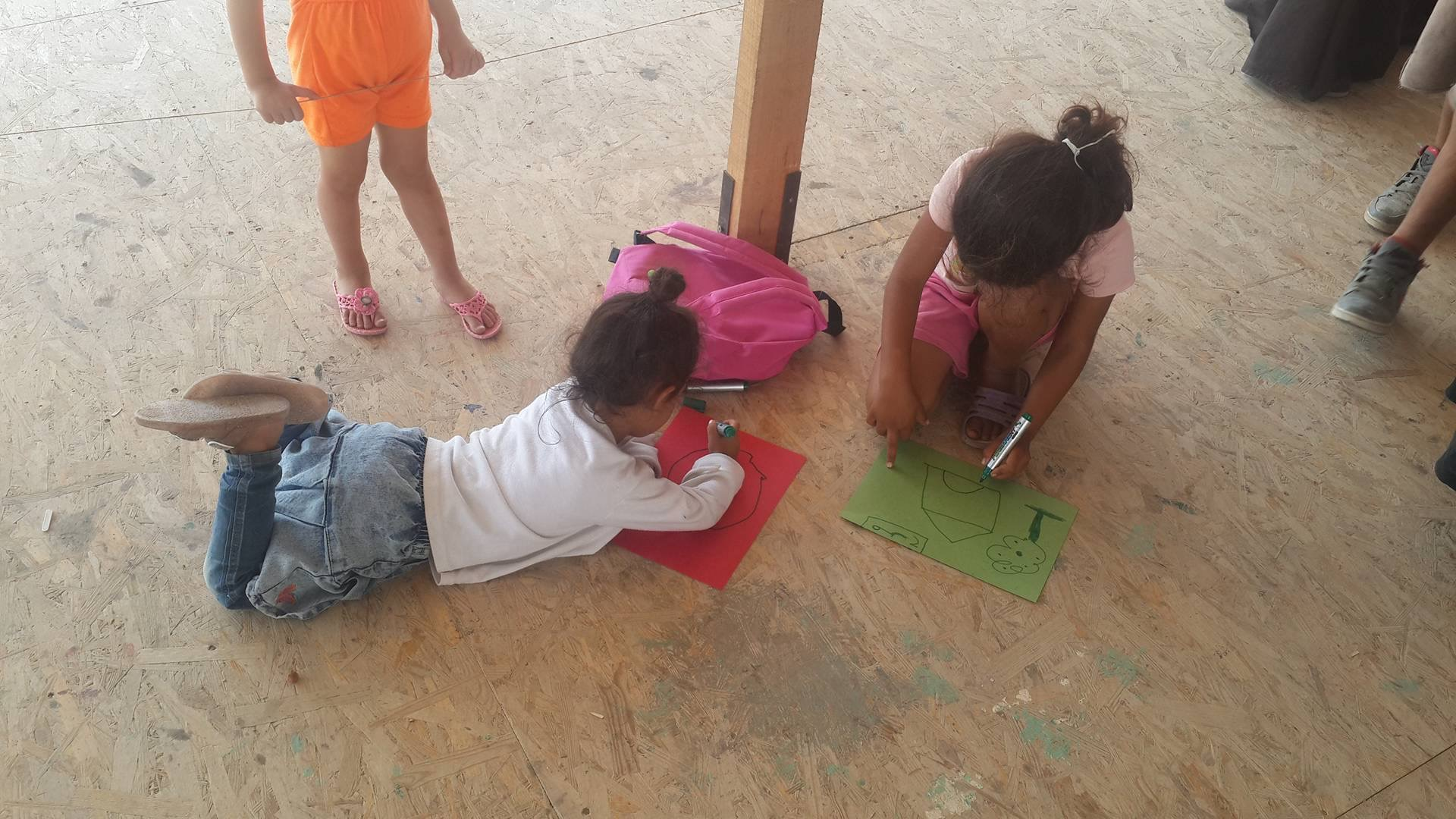 Kids drawing at a refugee camp in Greece.