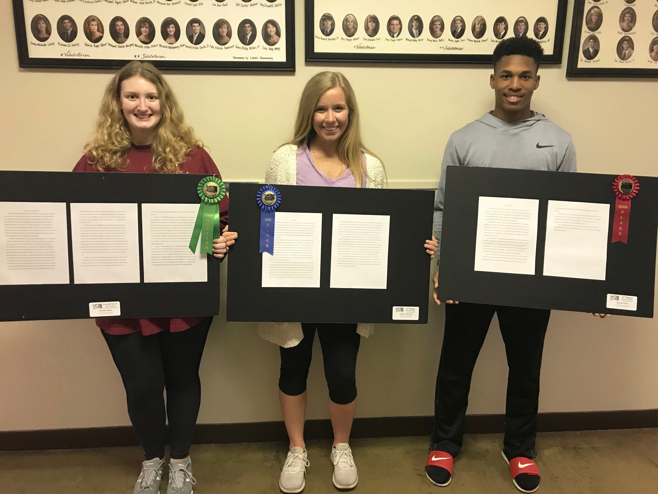 Pictured Left to Right are Seniors: Michaela Wells, Honorable Mention; Mallory Matthews, 1st Place; Dedrick Gates, 2nd Place; and Sara Lawrence, 3rd Place (not pictured)