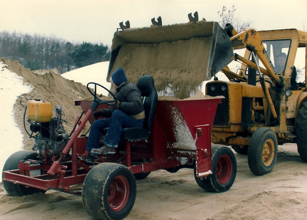 Winter, 1989 | Sand Buggy being Filled | Bogs are sanded every 3 years; many yards of sand are sieved each year before it gets to cold, in order to have enough sand ready to apply when the ice forms.