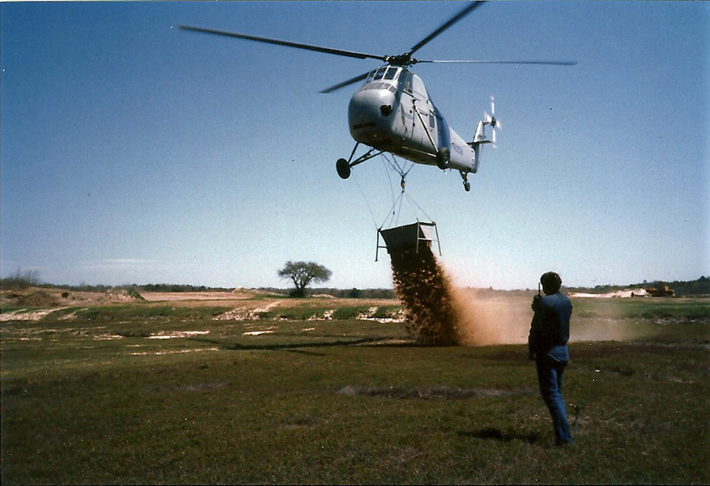 "Helicopter Dumps Sand on Bog | The goal was to evenly cover the bogs with an 1.25"" of sand; it took two years to sand the 14 acre."