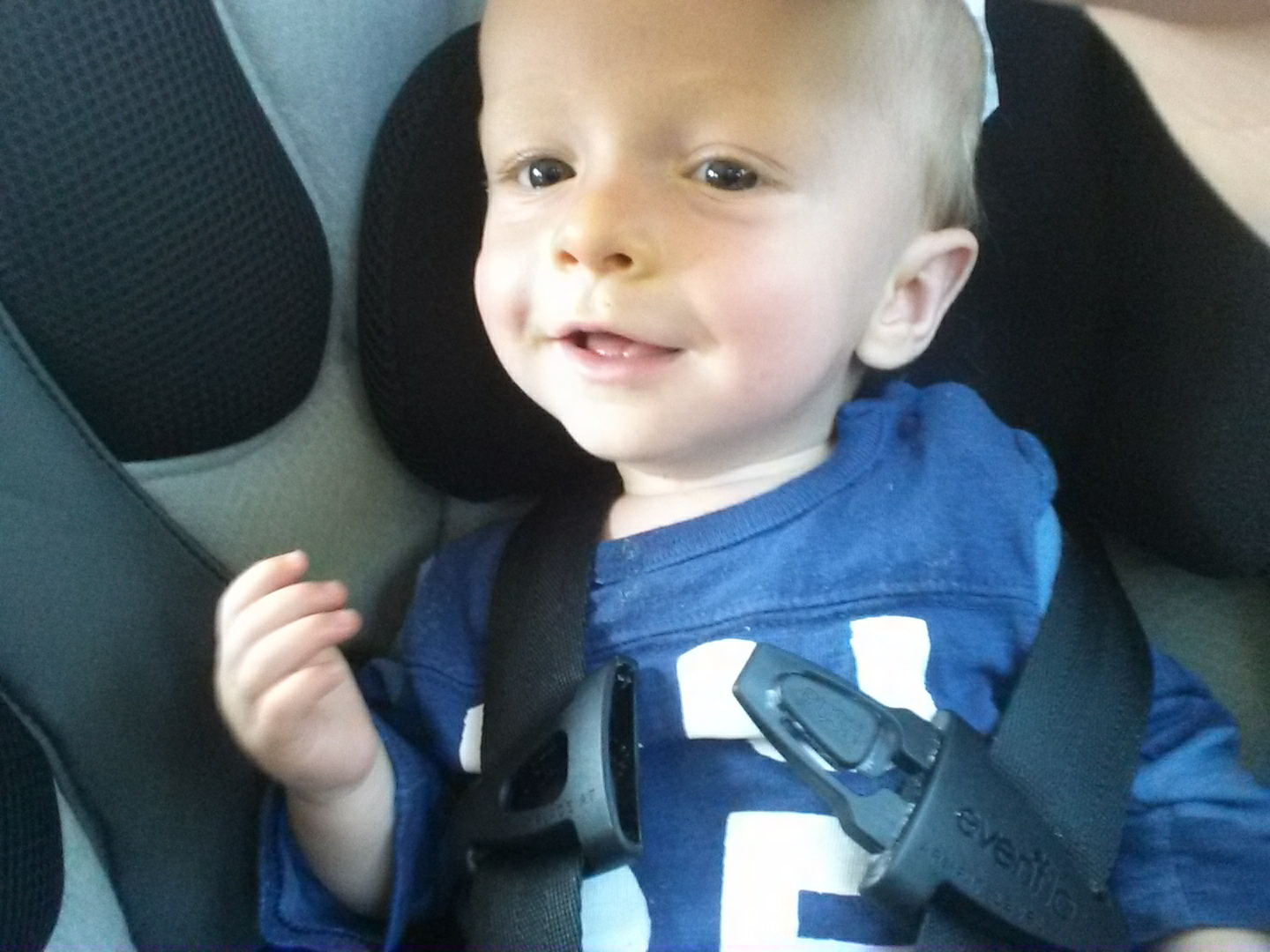 Reagan being a ham after he learned how to unclip his carseat strap