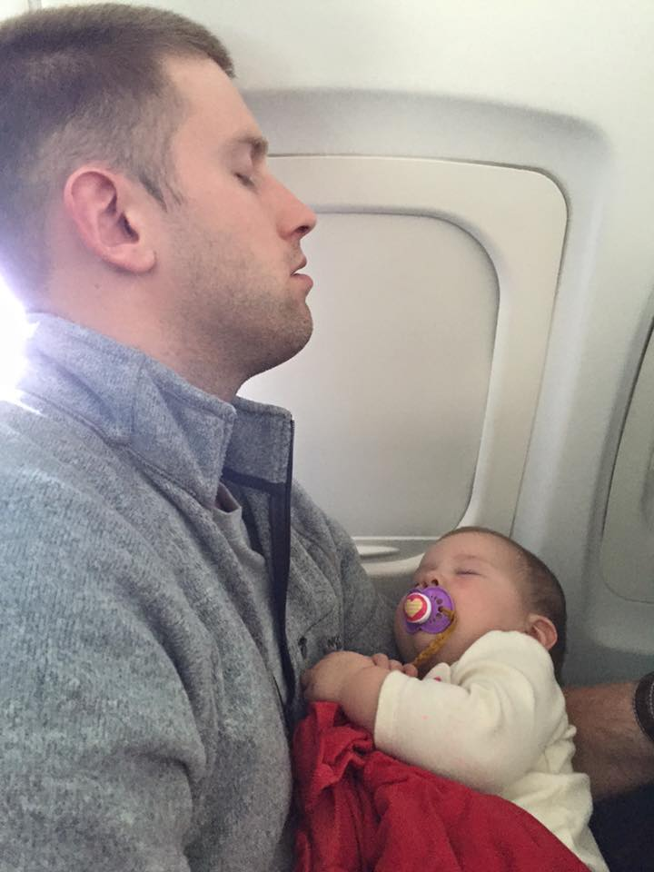 "My husband and daughter both asleep on a ""to EARLY"" flight"