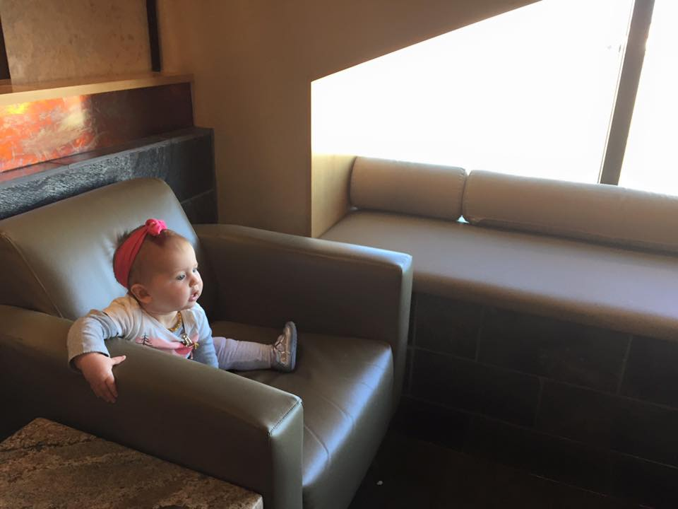 Here is our daughter enjoying comforts of the Delta Sky Lounge in Atlanta