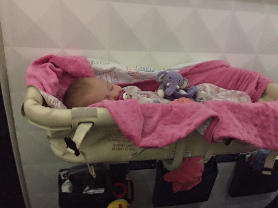 Our daughter in the Bassinet on our long international flight