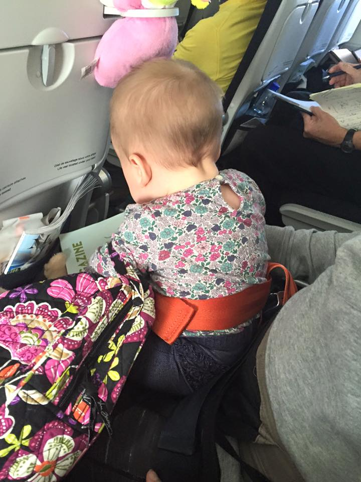 This was on our Air France flight from naples to paris -- yes, she had an additional seatbelt.