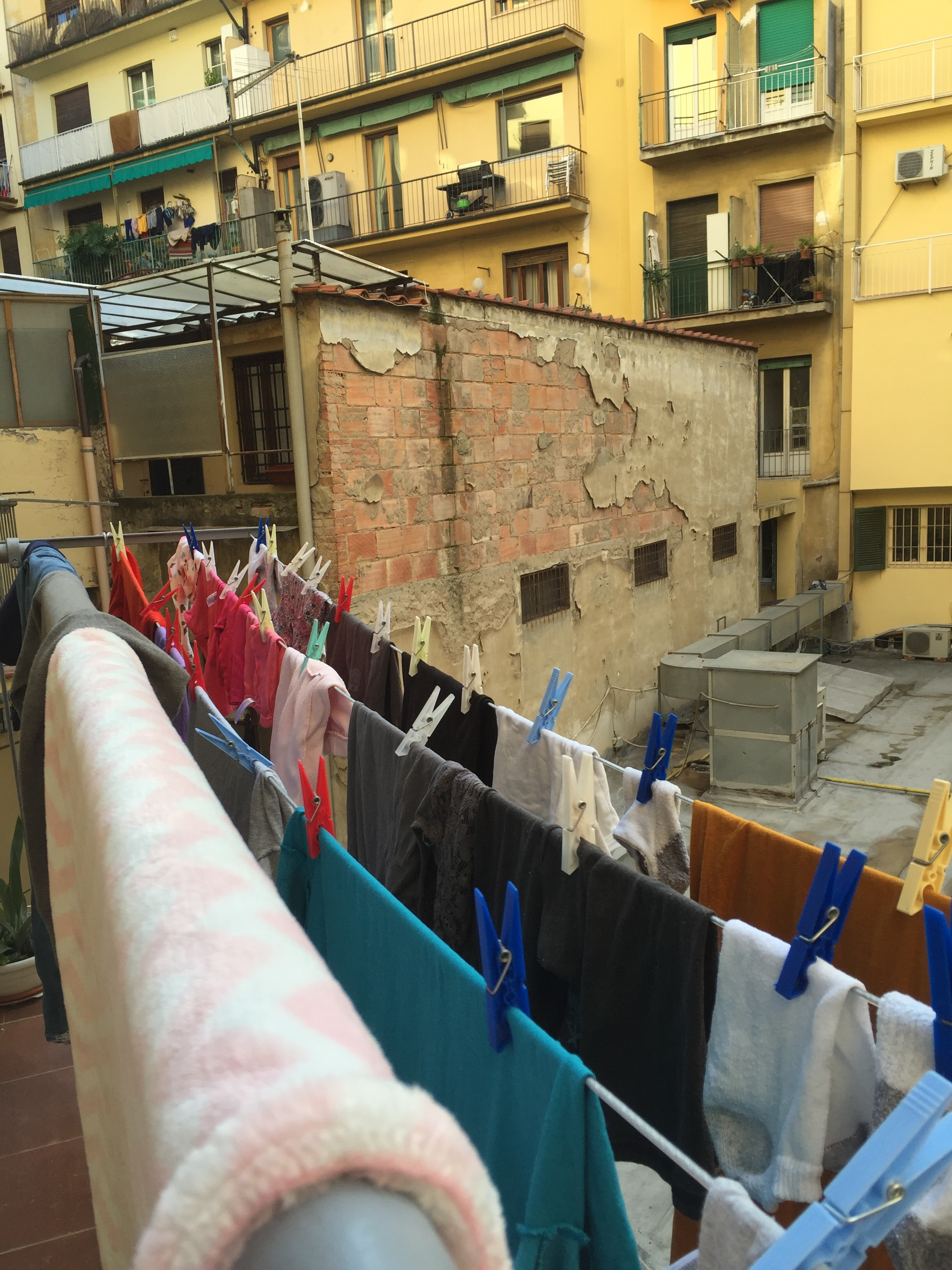 View to the courtyard from our Kitchen balcony -- we felt like locals with our clothes hanging to dry!! WE LOVED IT!! Florence, Italy
