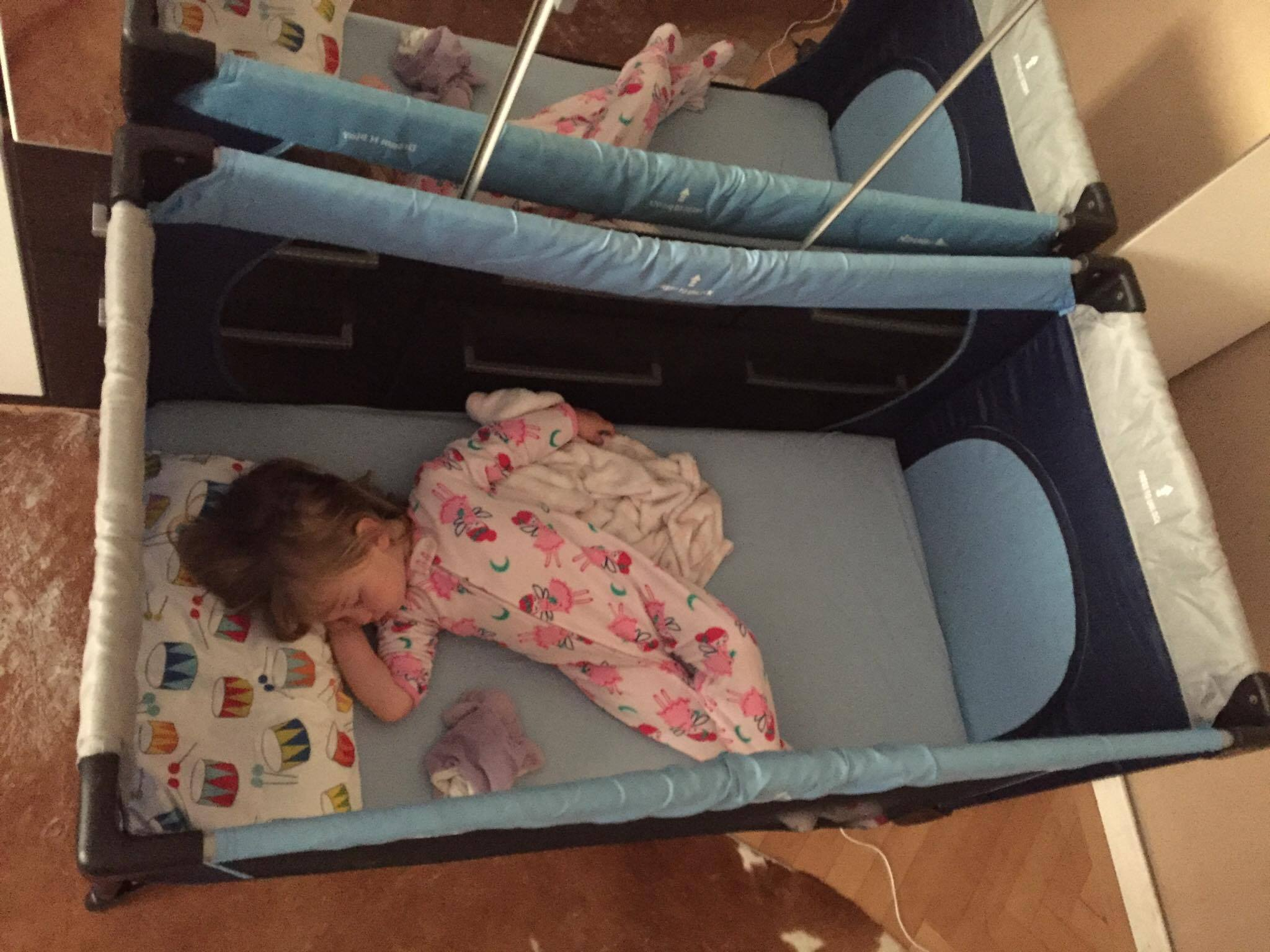OUr daughter (2 years old) sleeping in an extended pack n play -- she has So much room