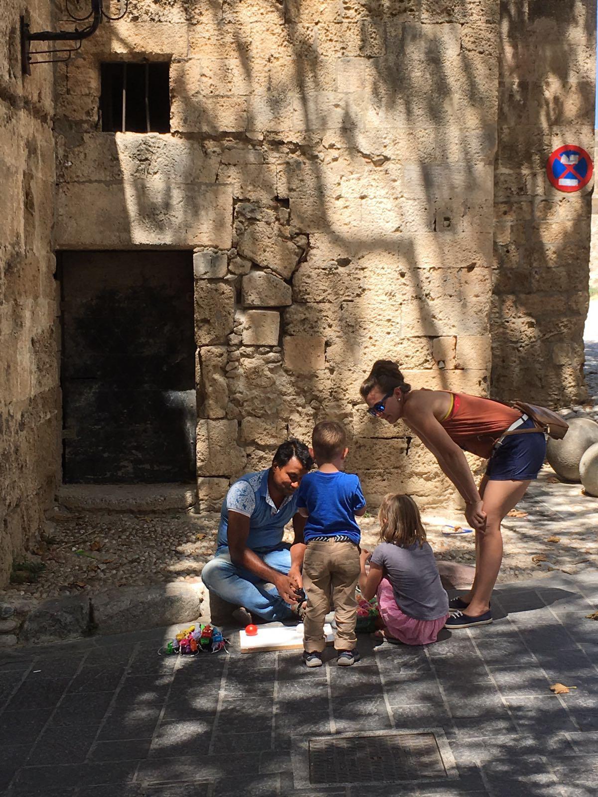 Jenny + The kids bartering in Greece