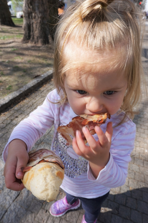 What in the?! She's actually eating the meat off her pastry.