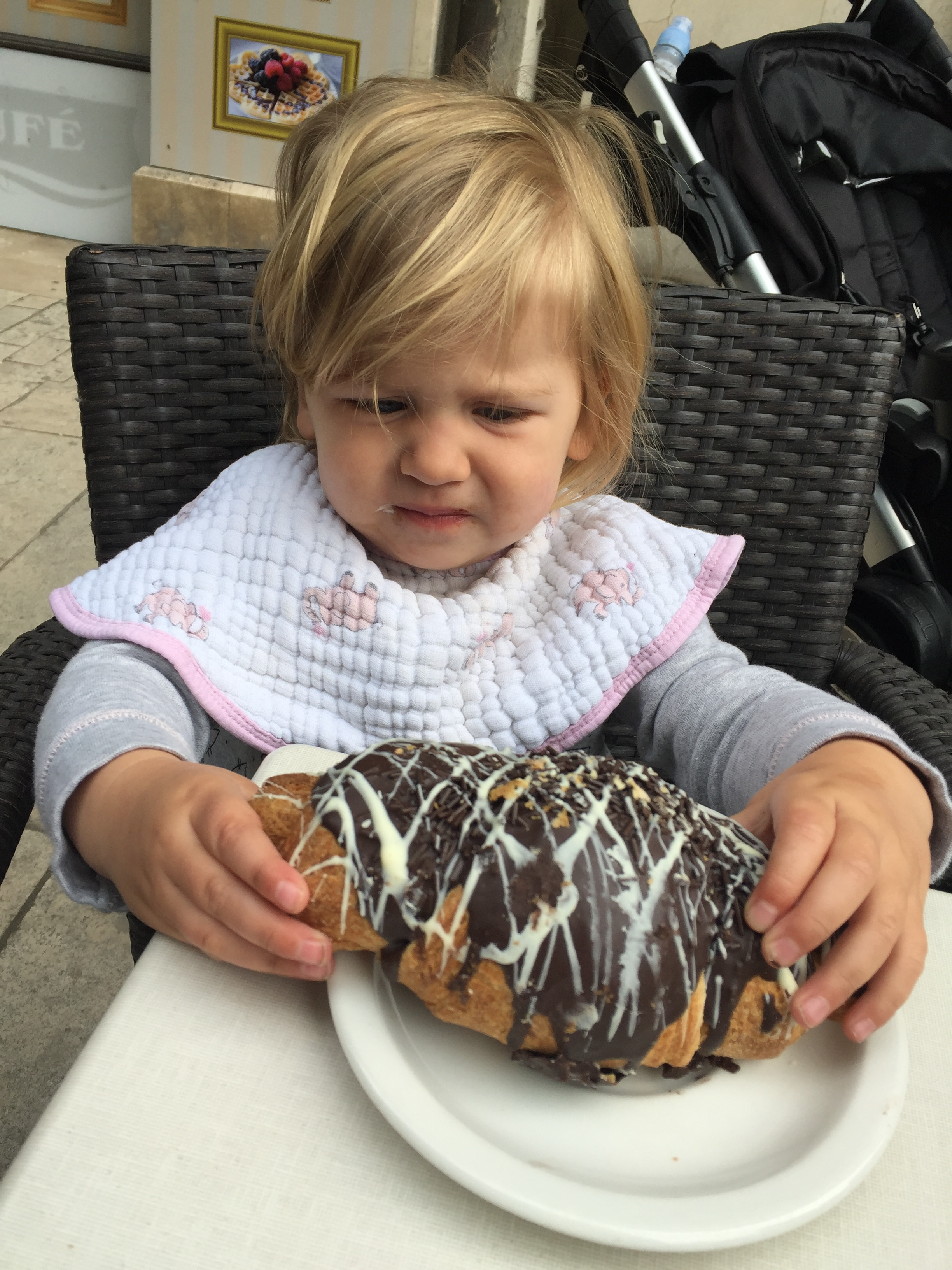She looks unimpressed, but she ate a lot of that giant pastry