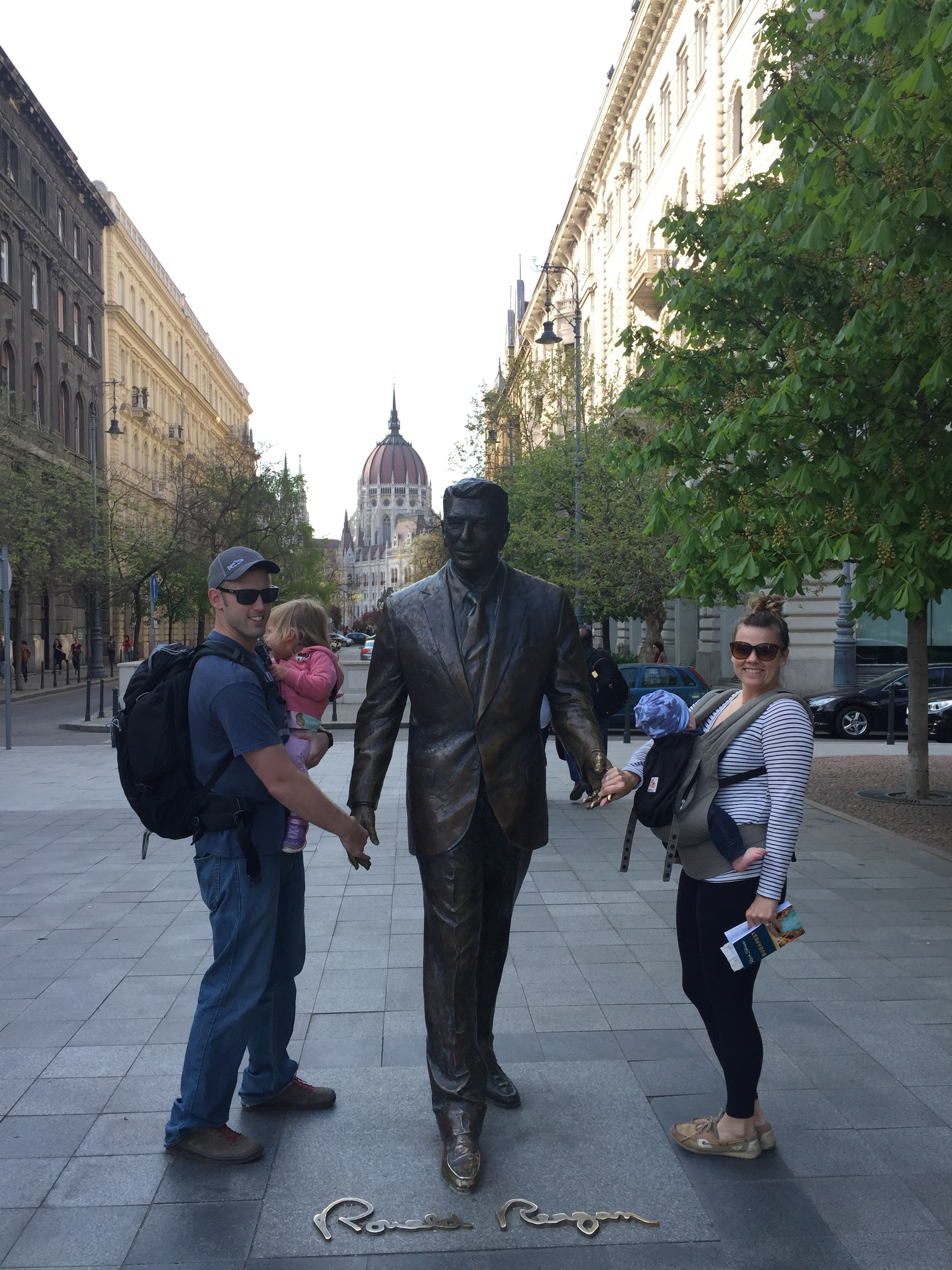 The Nomads posing with the Ronald Reagan Statue