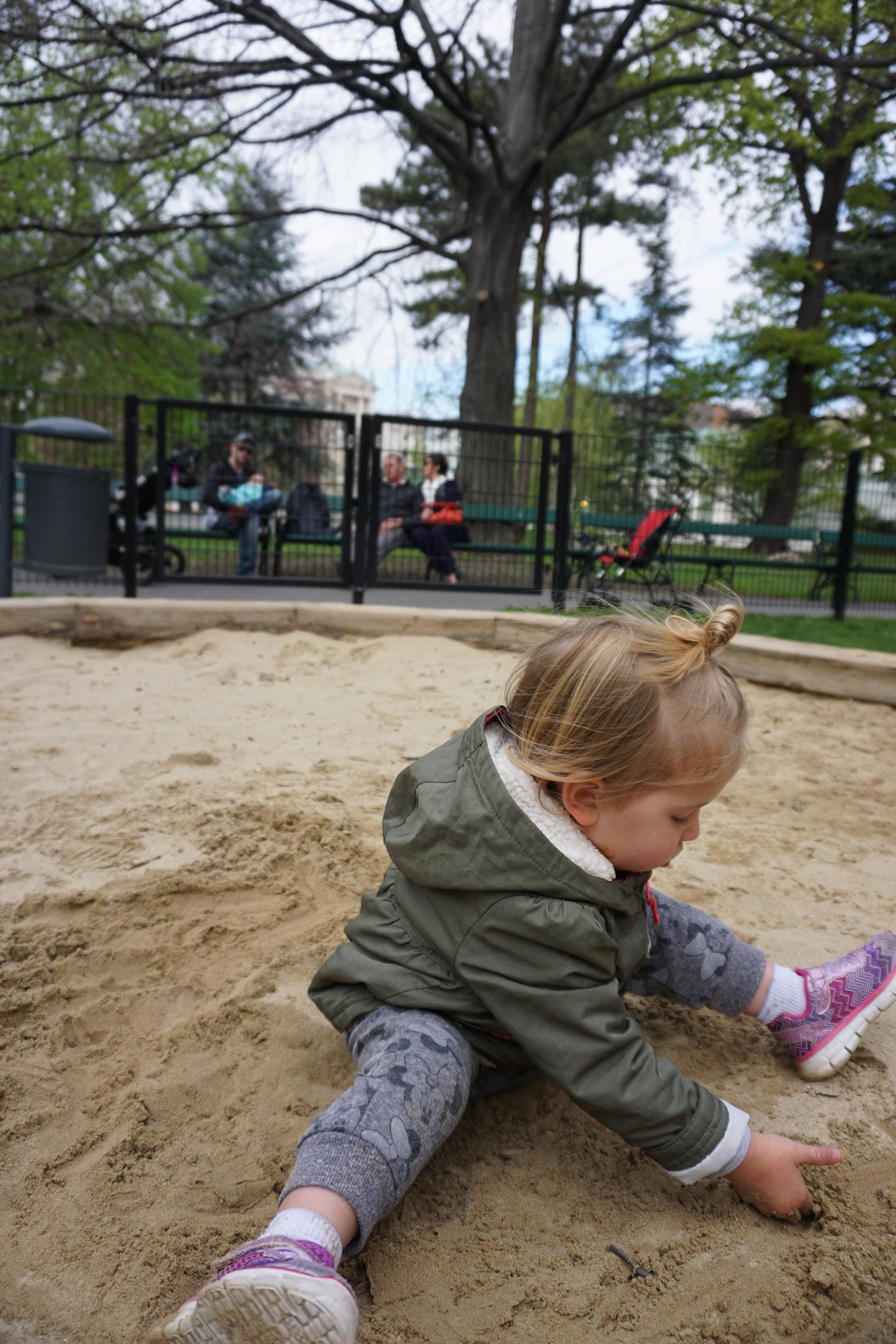 CHarletta playing the kids sandbox at hofburg palace