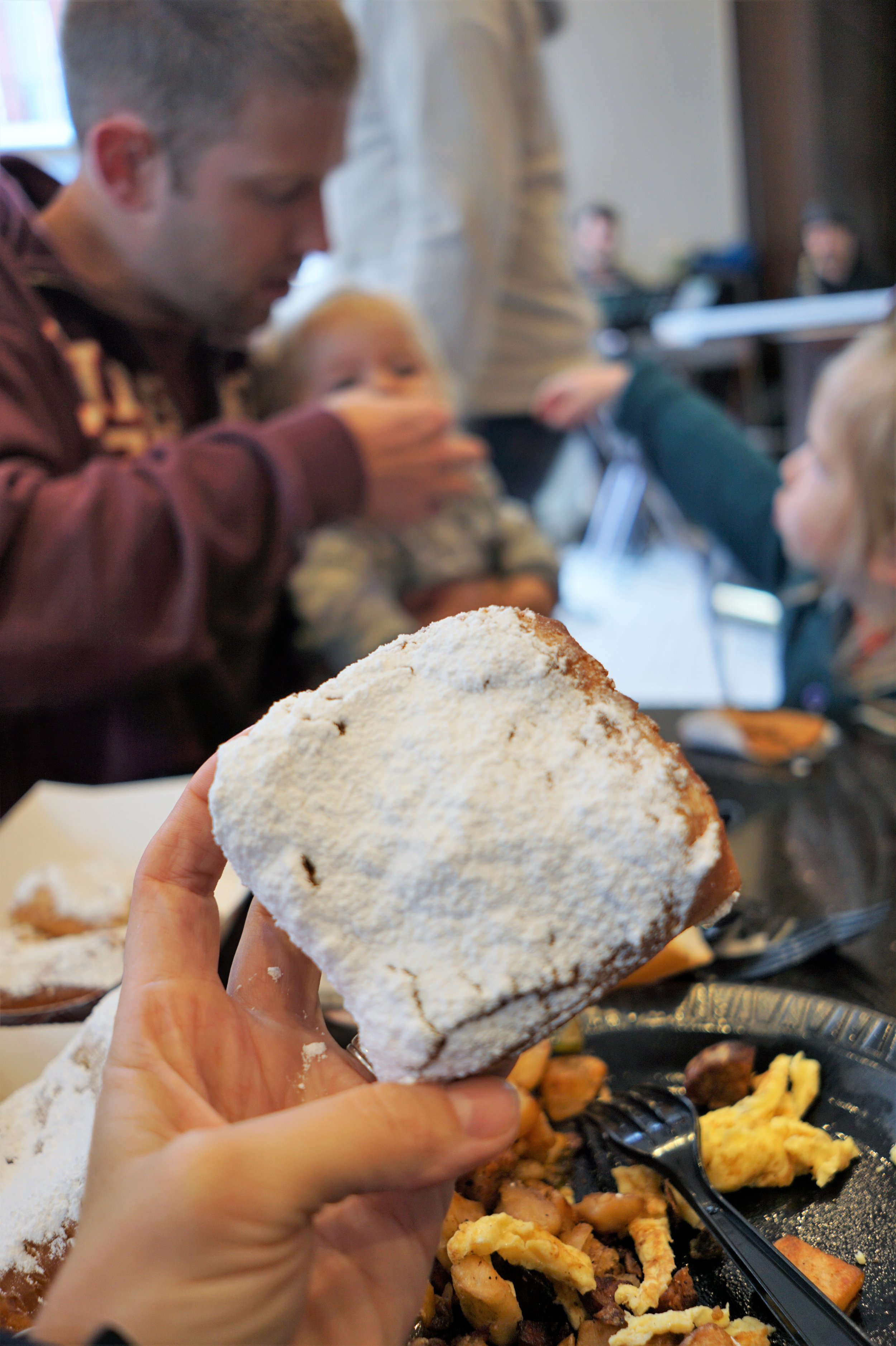 Everyone enjoying these giant beignets at Cafe Beignet!