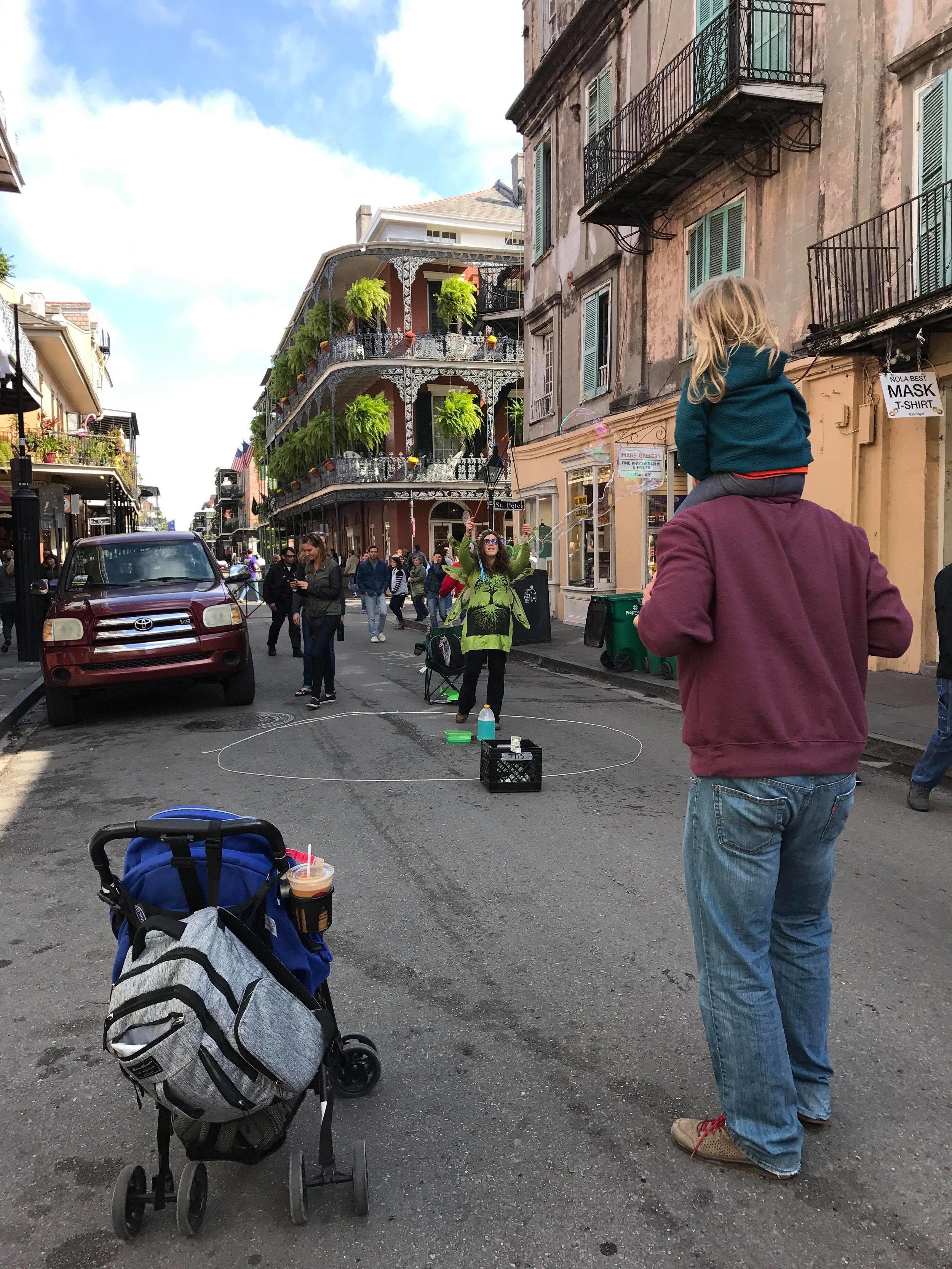 Enjoying the bubble street performer