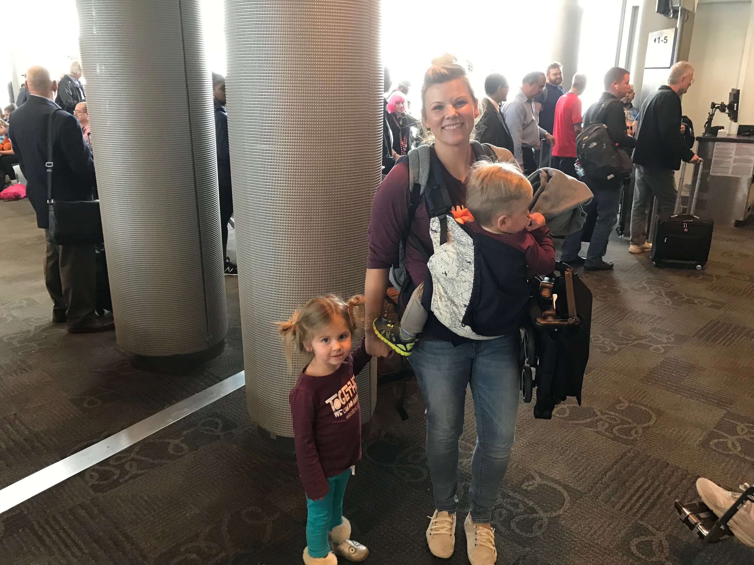 Backpack Diaper Bag + Stroller is all we used when I flew from Florida to Texas with the kids by myself