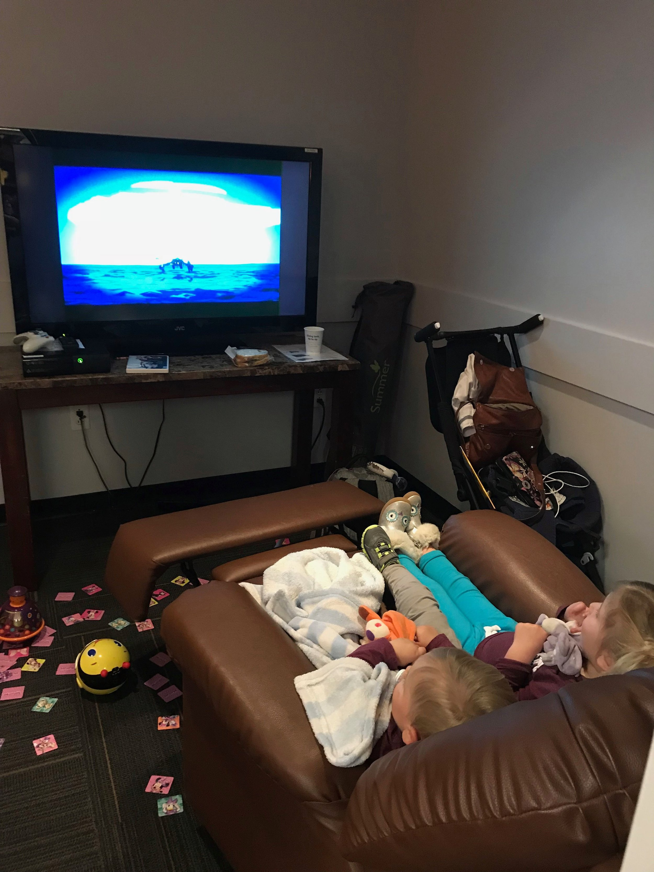 The kids watching a movie in the USO in Houston during a 3 hour layover