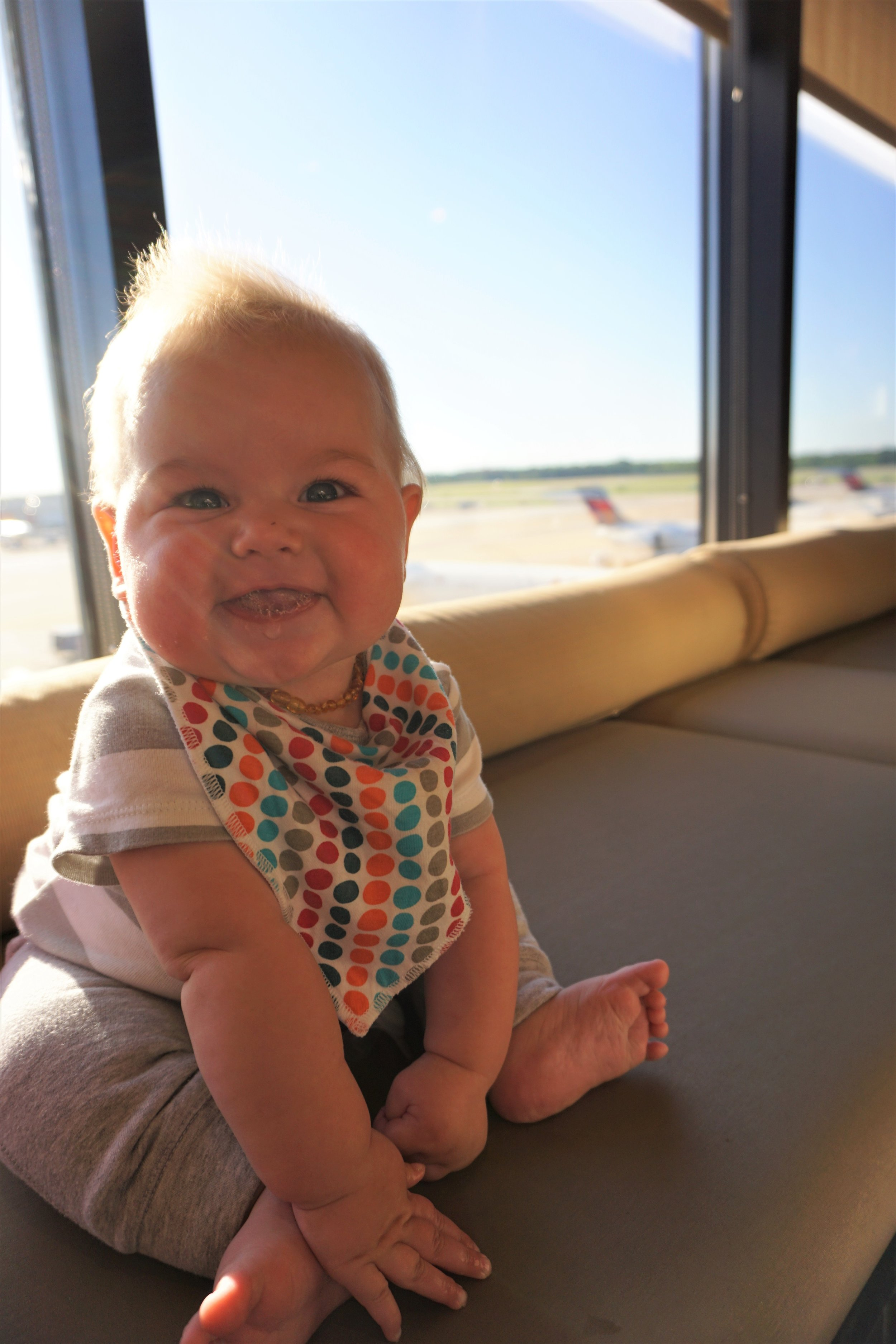 our littlest nomad in the atlanta delta sky club on the way from florida to Burlington, vt