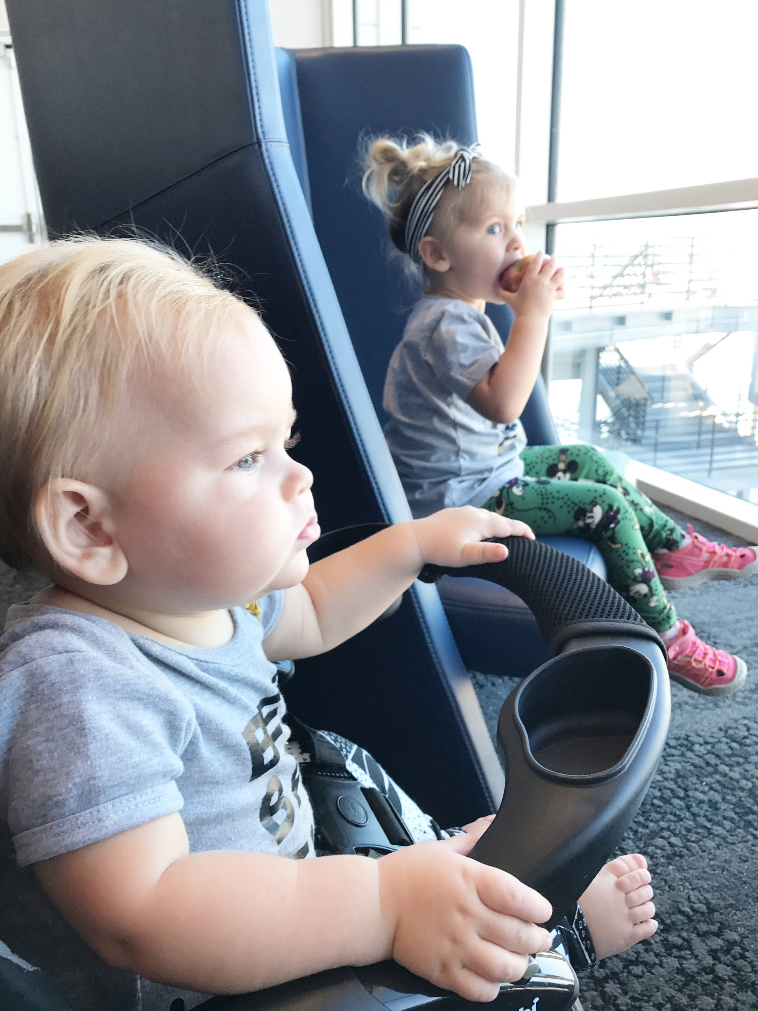 The baby nomads are enjoying some privacy seats, free snacks and great views from the floor to ceiling windows.