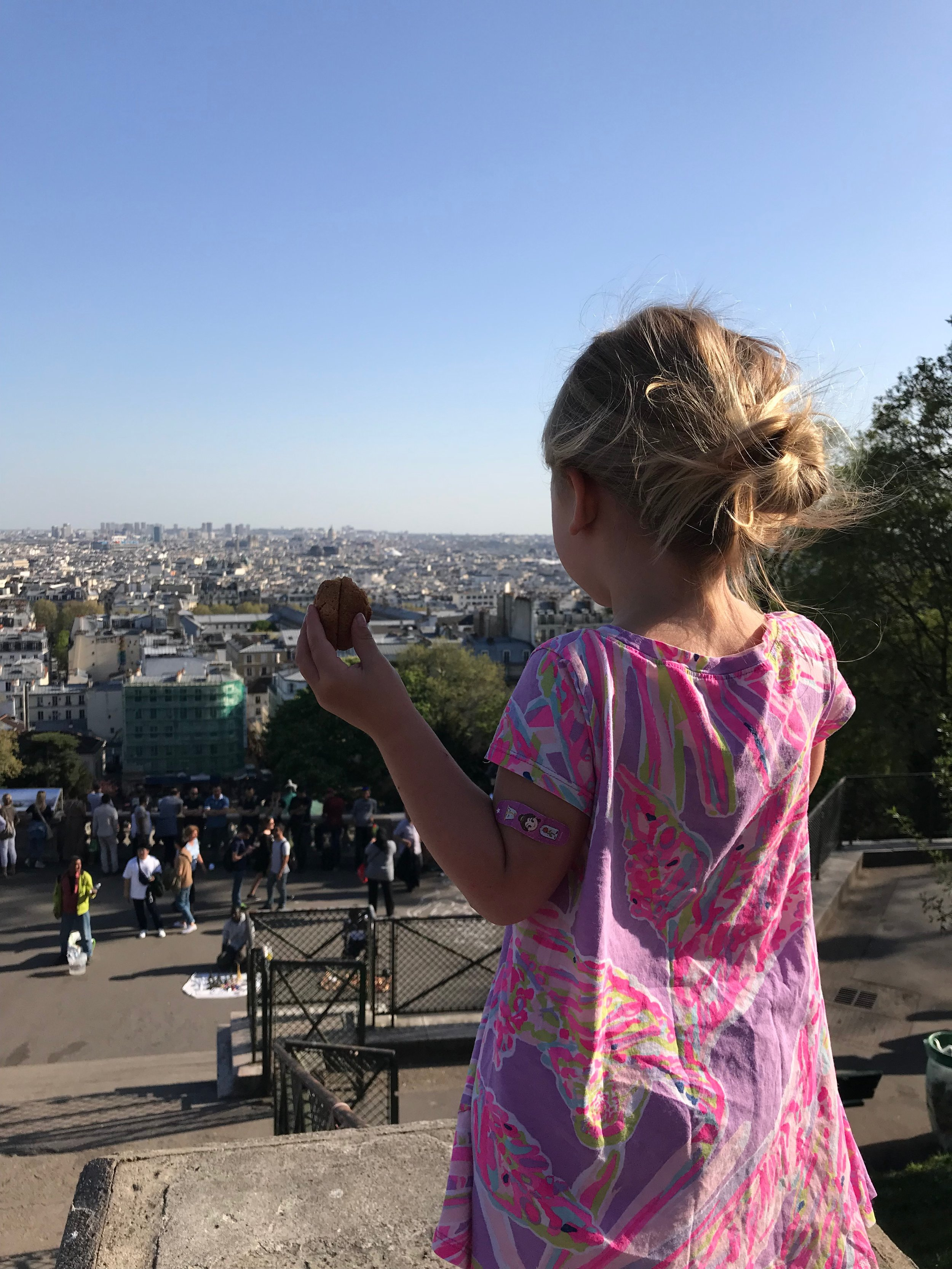 My girl eating macaroons taking in paris