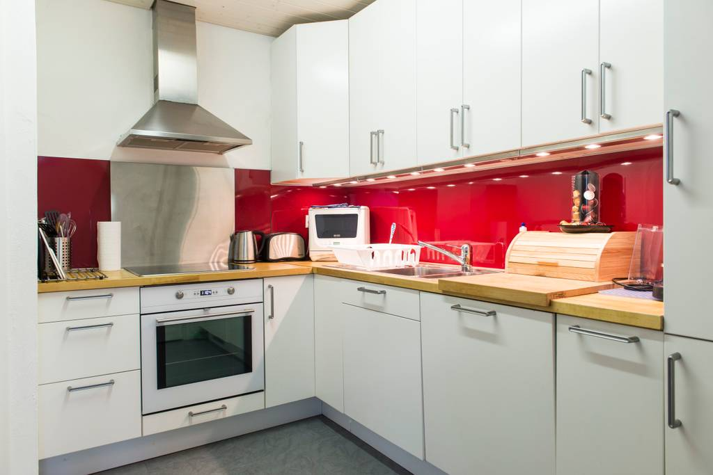Check out our kitchen in bern!  We had so much space for the kids to play, cook food, relax and enjoy the views of the river & Bern!  All for less than the price of a studio hotel room!