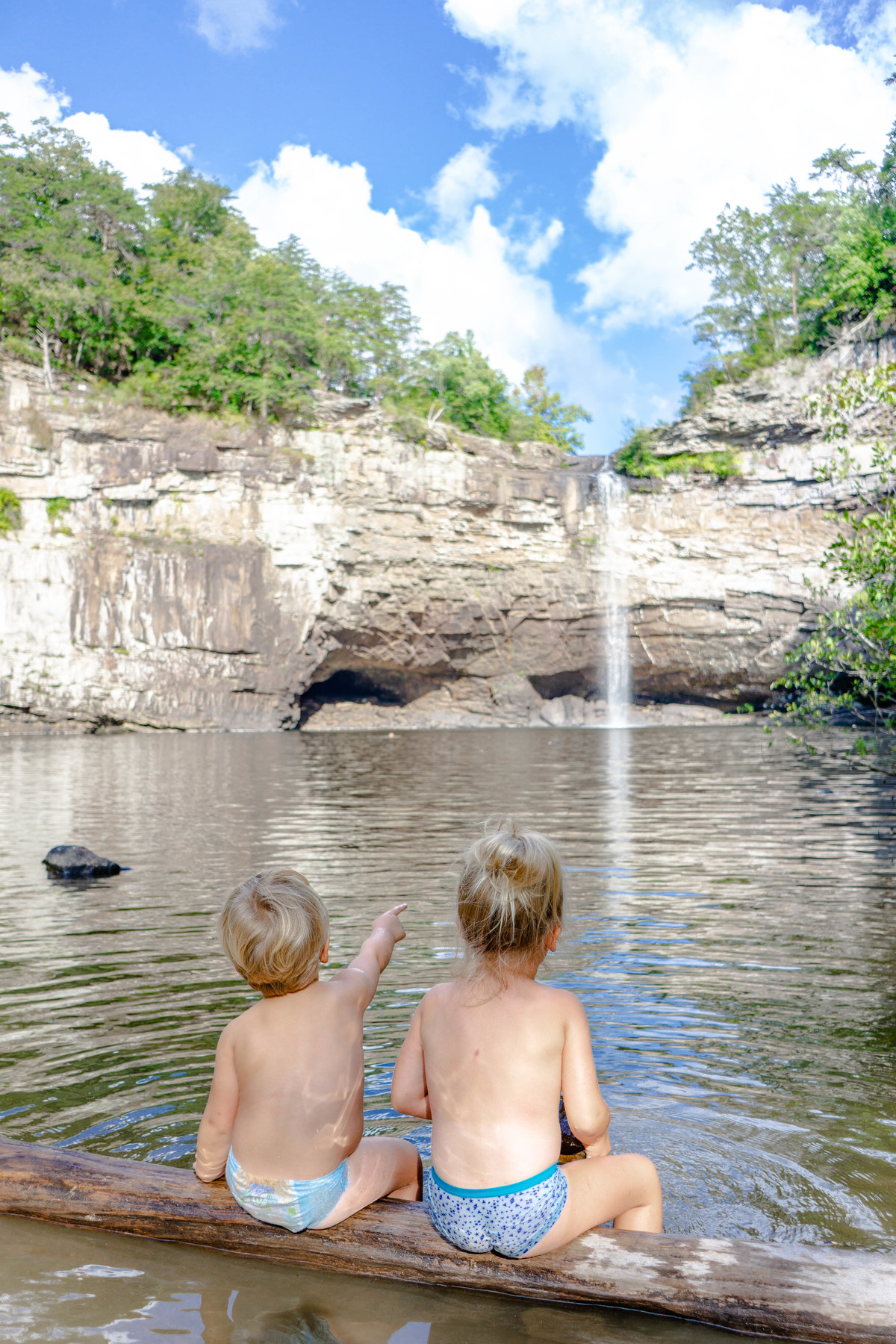 The Toddler Nomads LOVED swimming on the beach under Desoto Falls