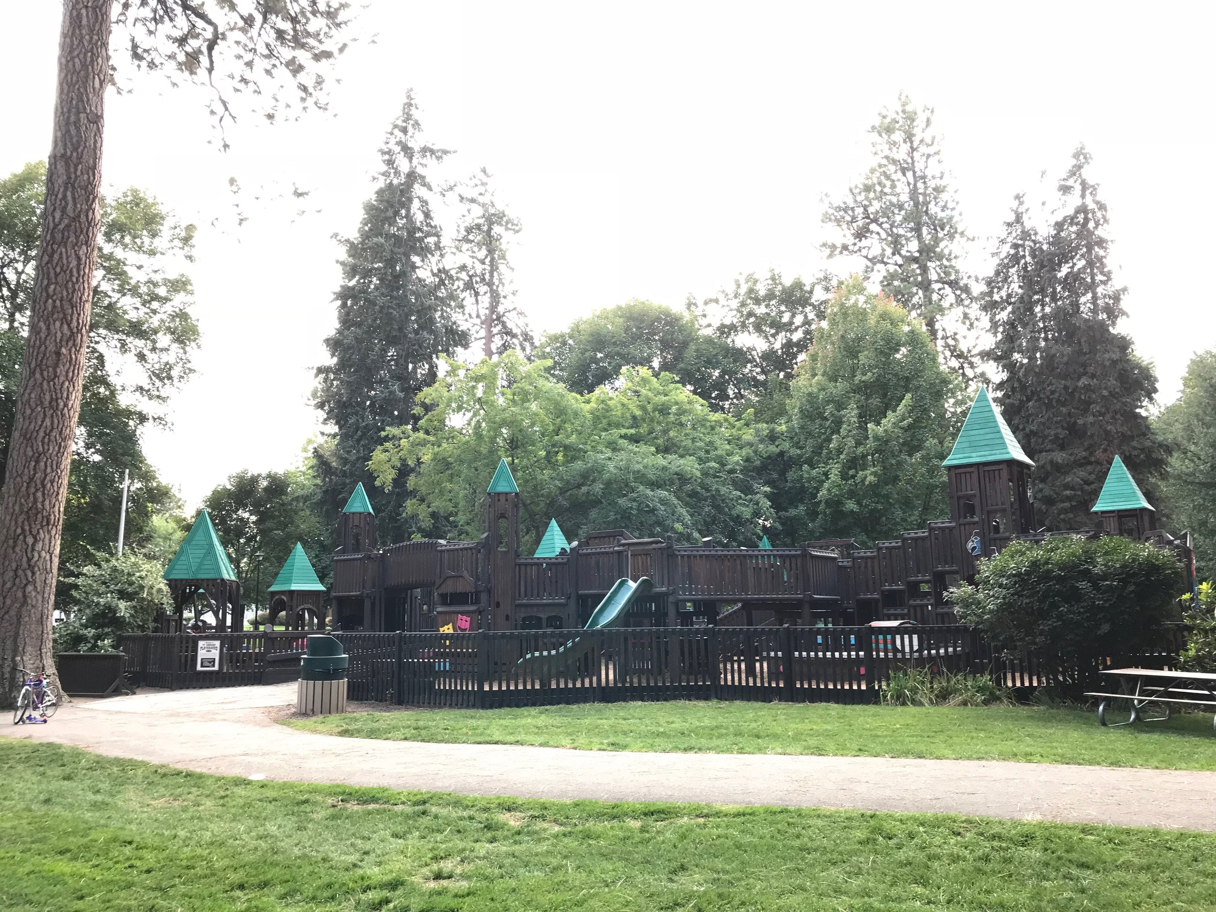This contained playground has two sides; big kids and toddler