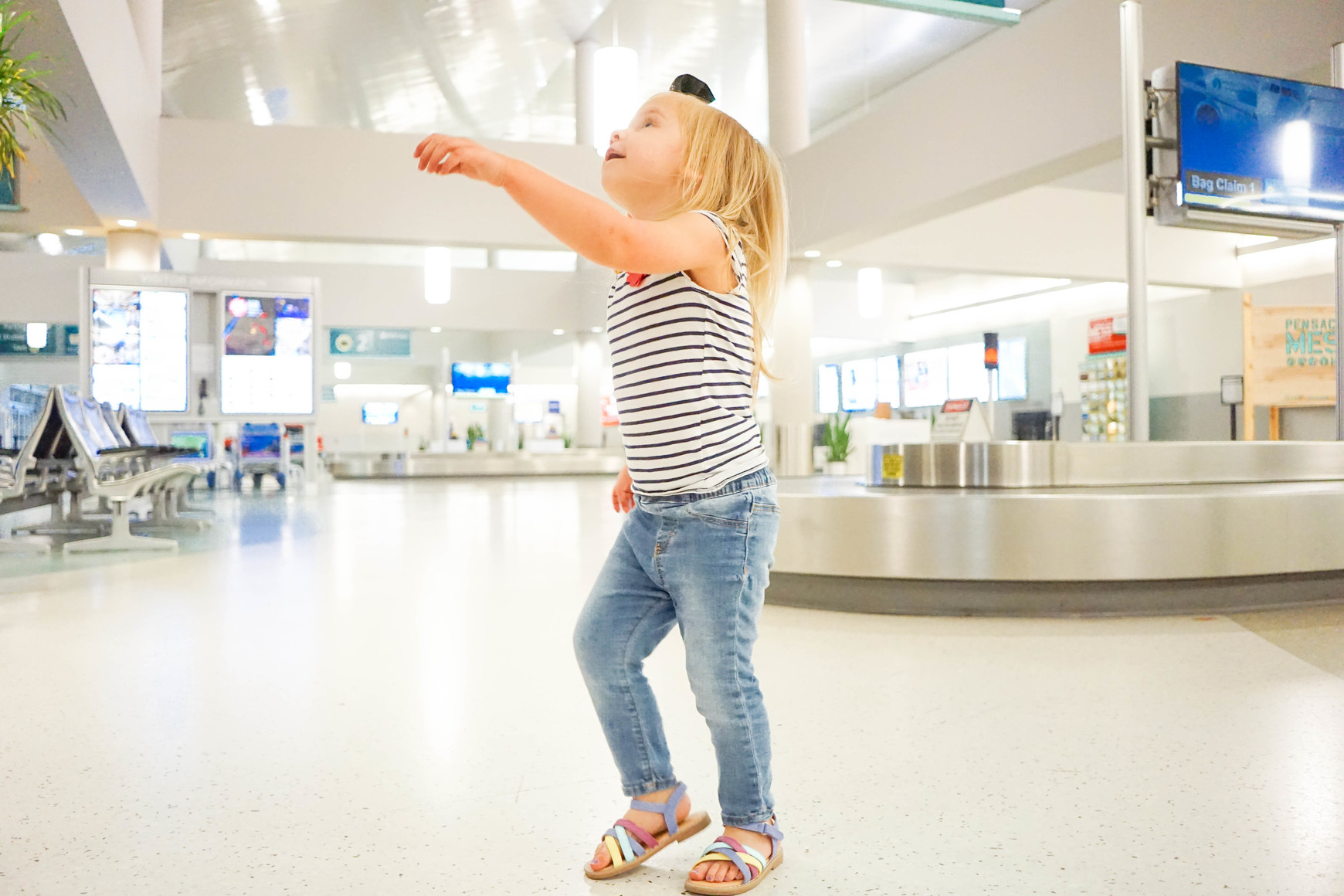 Charletta running through the pensacol airport