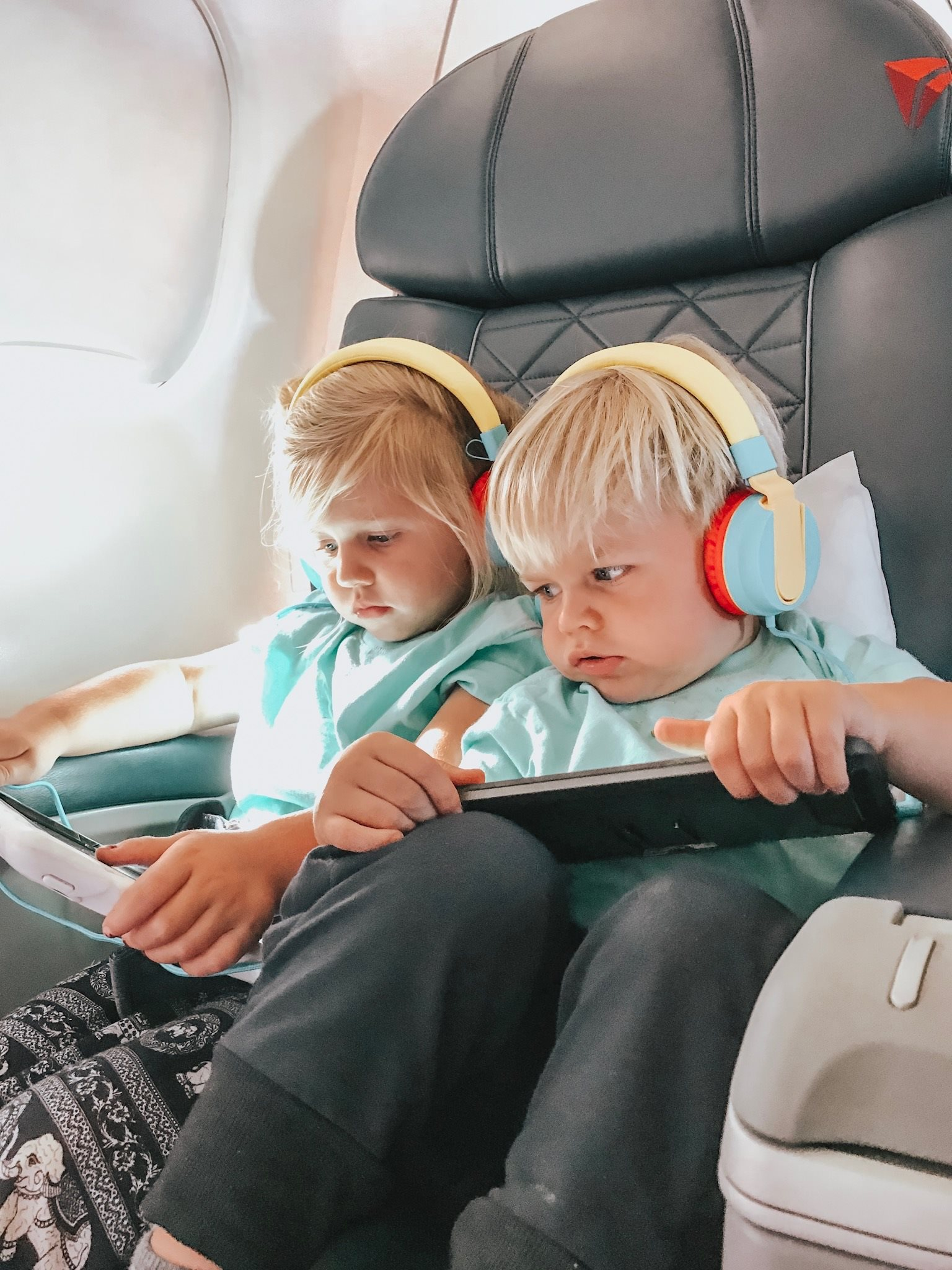 The Kids with their headphones & ipads playing games.