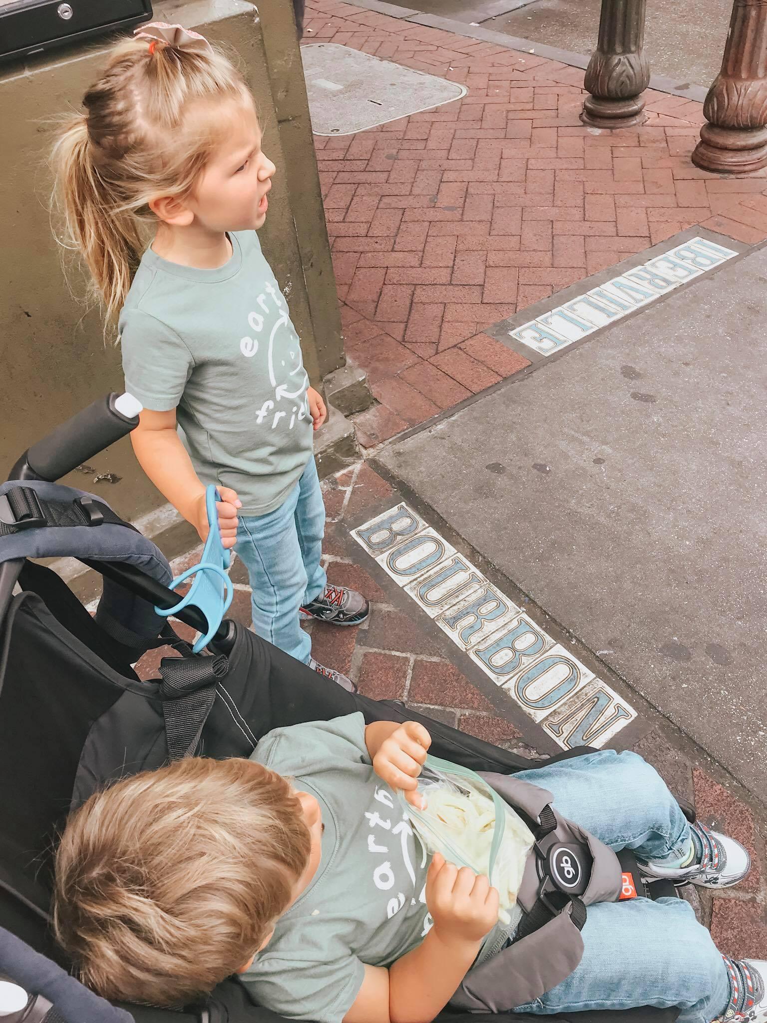 The kids waiting to cross Bourbon Street